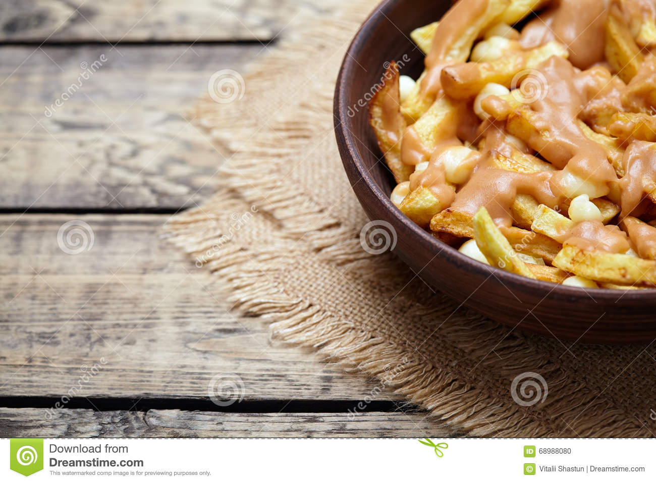 Poutine Canadian homemade traditional fast food meal with fries