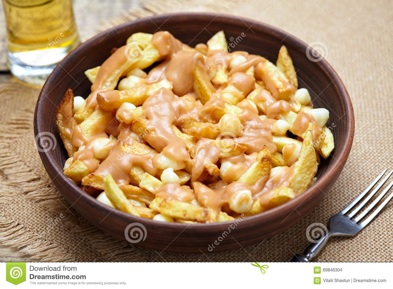 Poutine canadian traditional fast food with fries curd for Authentic canadian cuisine