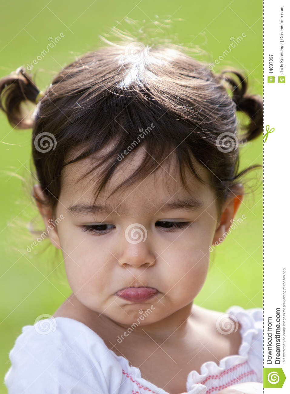 pouting little girl outdoors stock image