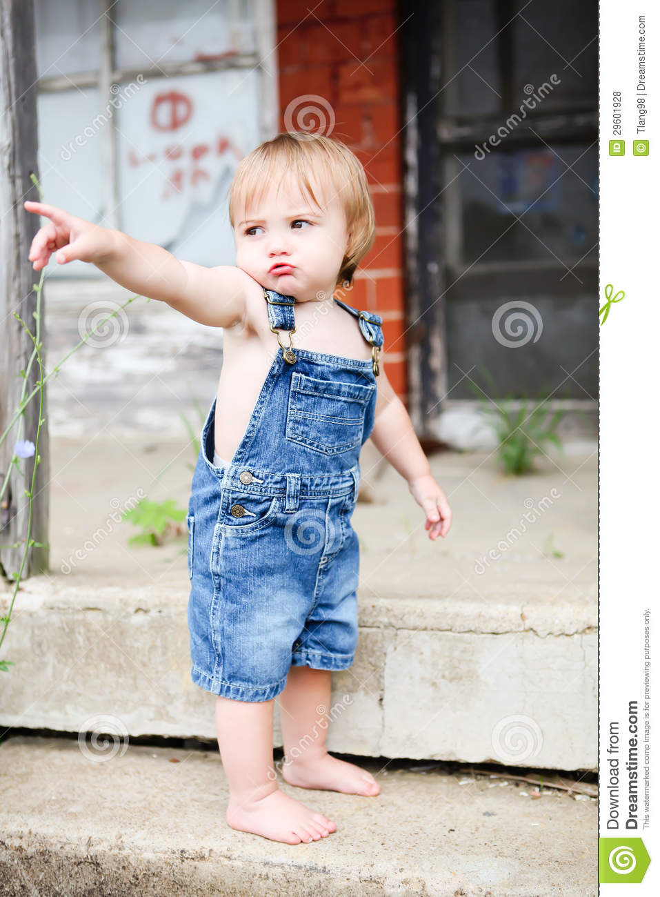 Pouty Little Boy In Overalls Stock Photo Image Of