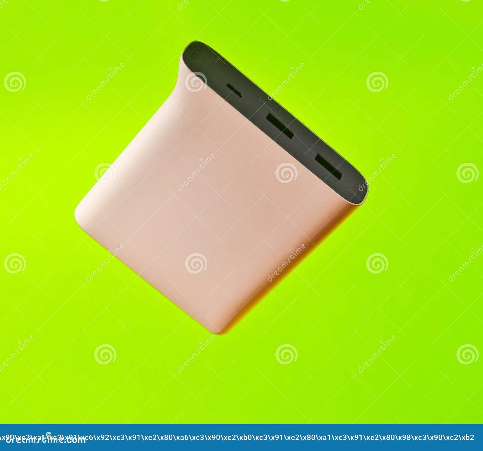 Power Bank Pale Pink Color On A Green Background. External Batt ...