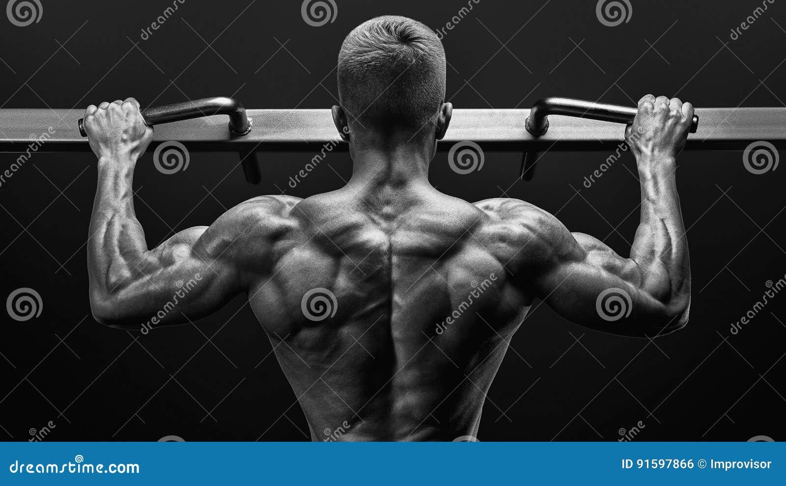 Power Muscular Bodybuilder Guy Doing Pullups In Gym  Fitness