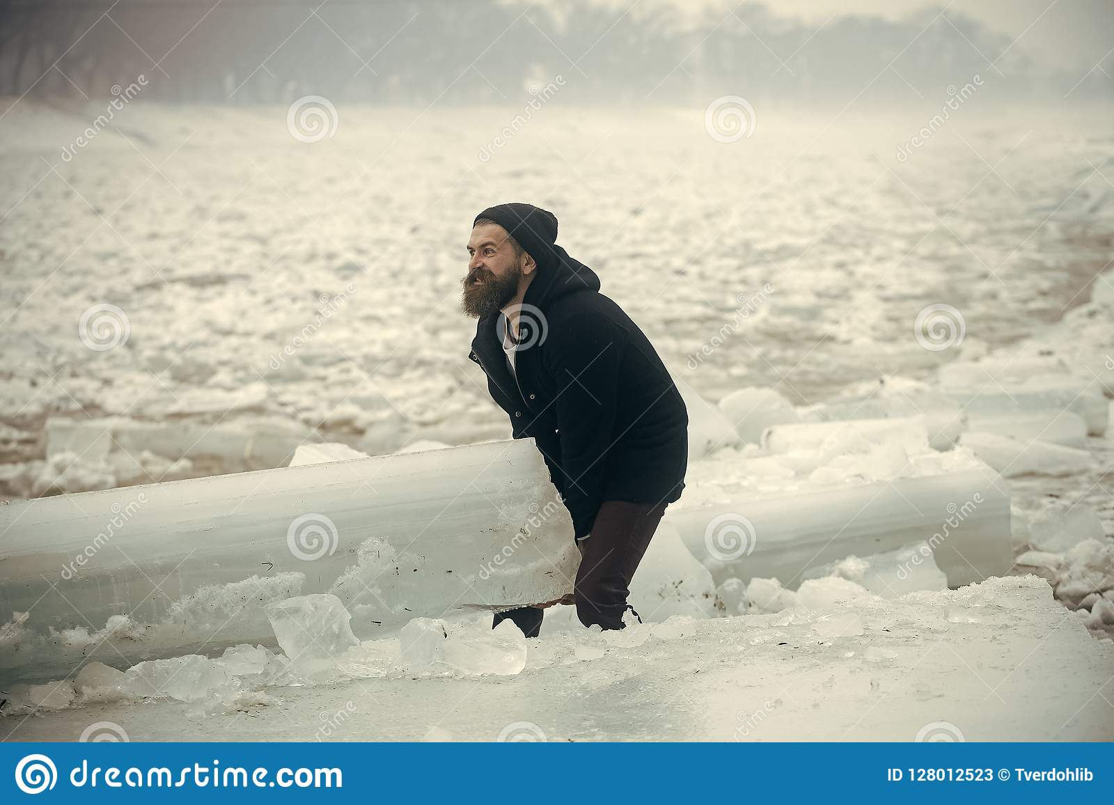 Power And Strength Of Man With Frozen Hummock. Stock Image - Image ...