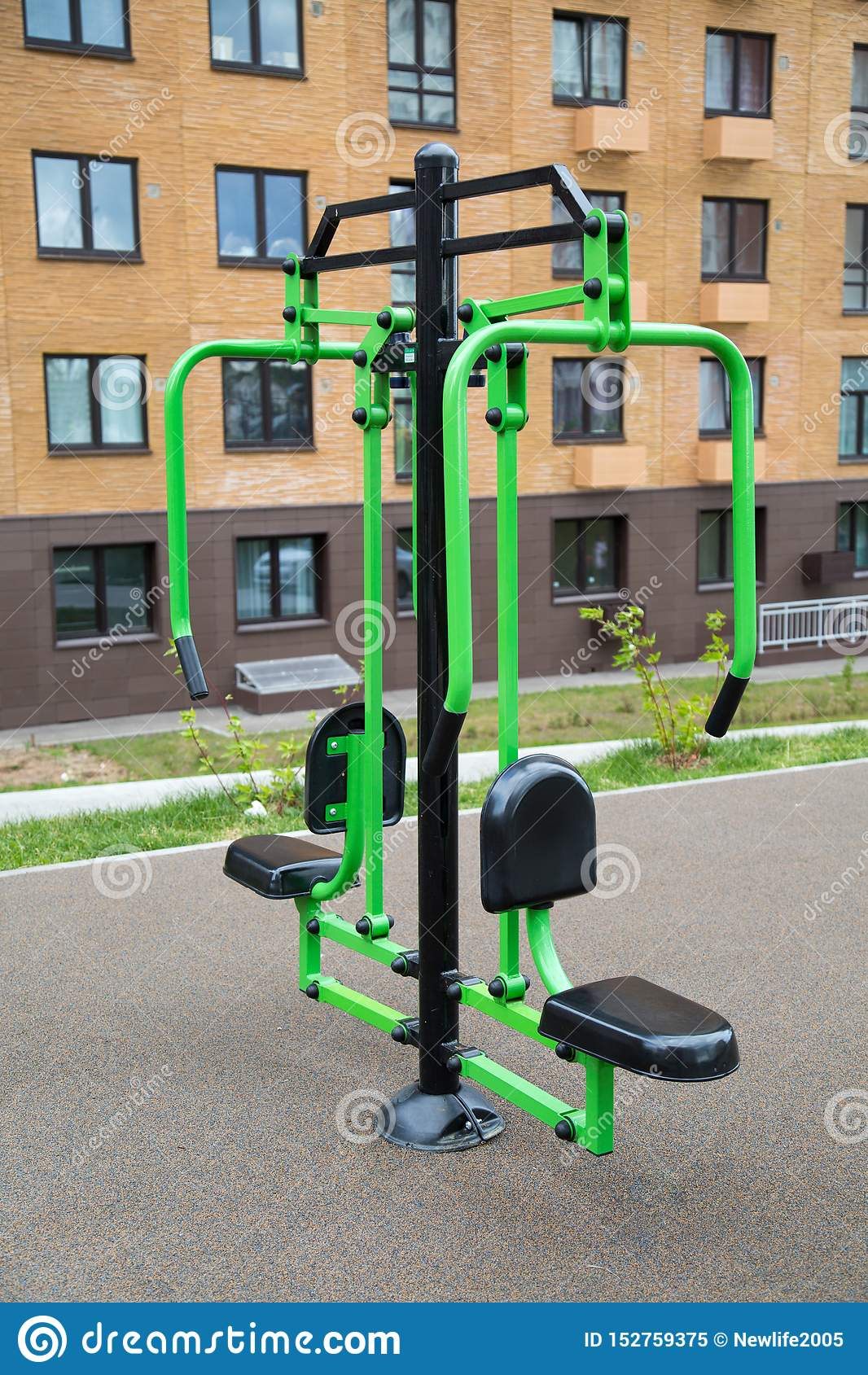 Power trainer for hand muscles made of metal on the Playground in the city outdoors. Sport is a healthy