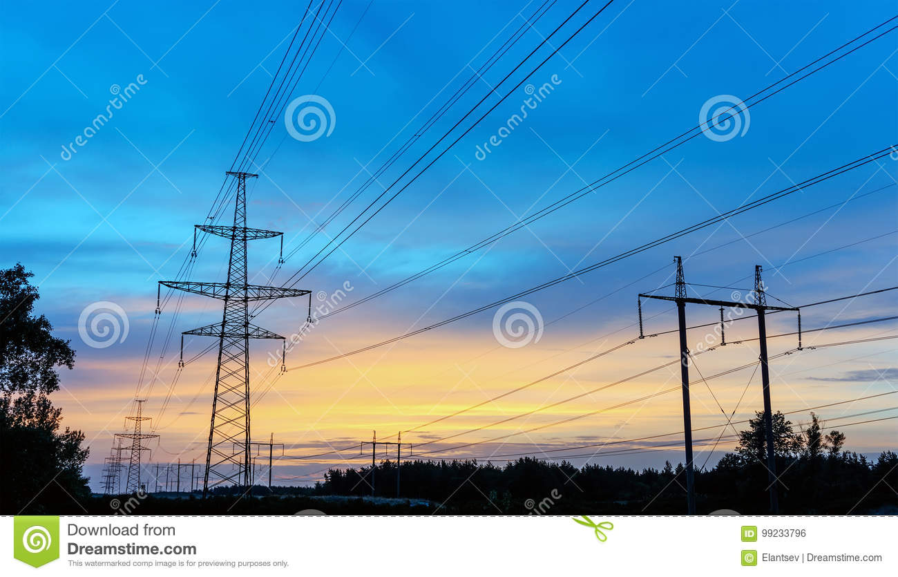 Power transmission tower silhouetted against the sunset glow.
