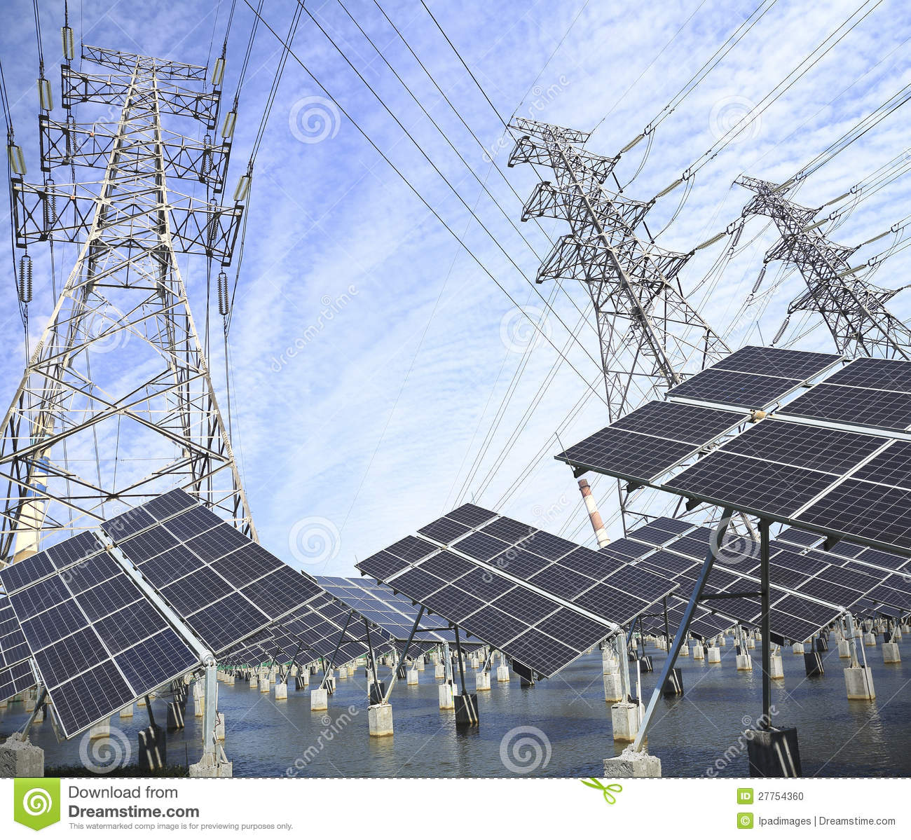 Power Transmission Tower And Solar Panel In The Green