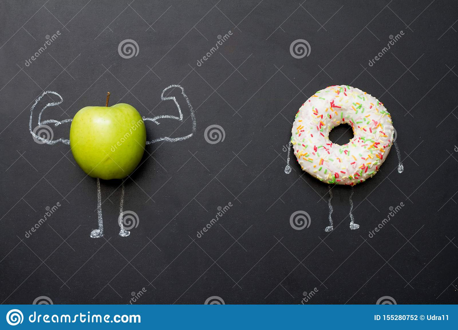Power of vitamins diet abstract concept with green muscles apple on blackboard