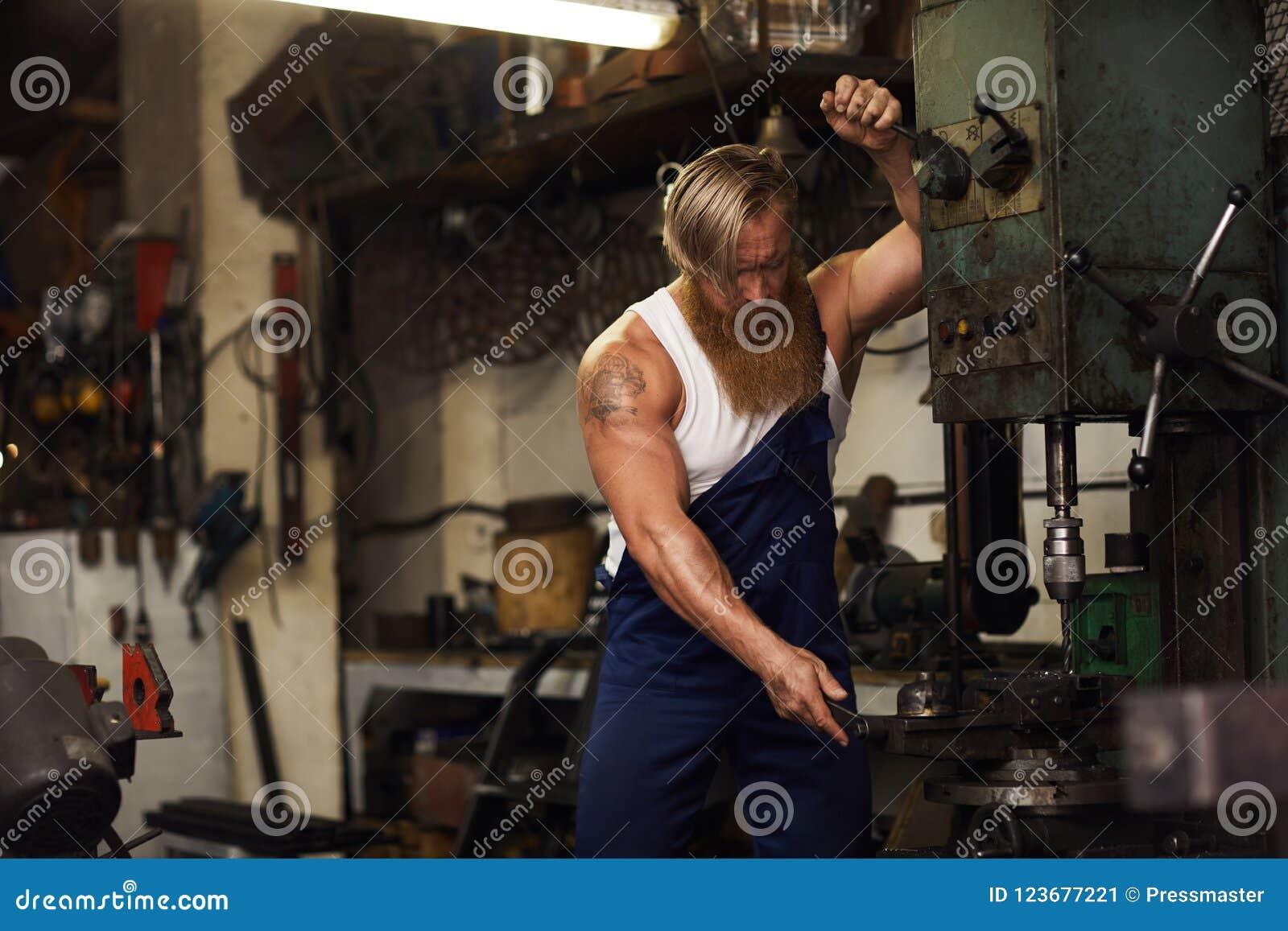 Tattooed body builders drill raw