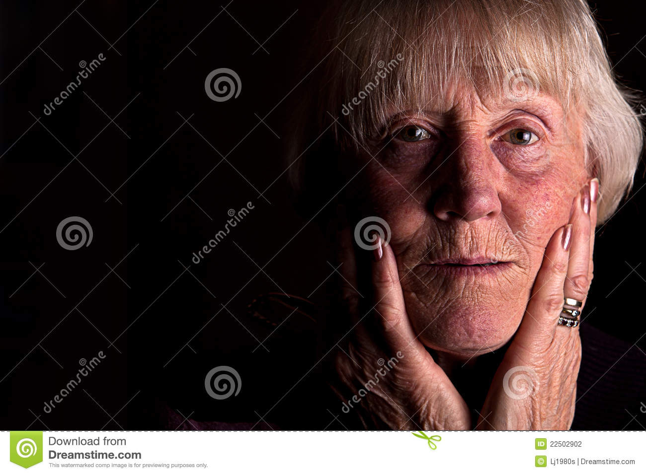 Powerful low key image of a senior woman