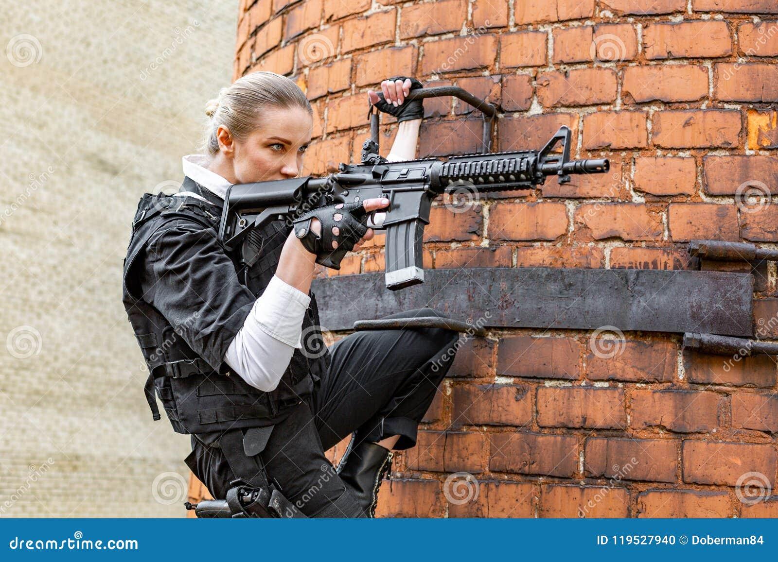 Powerful Woman Holding Gun  War Action Movie Style Stock
