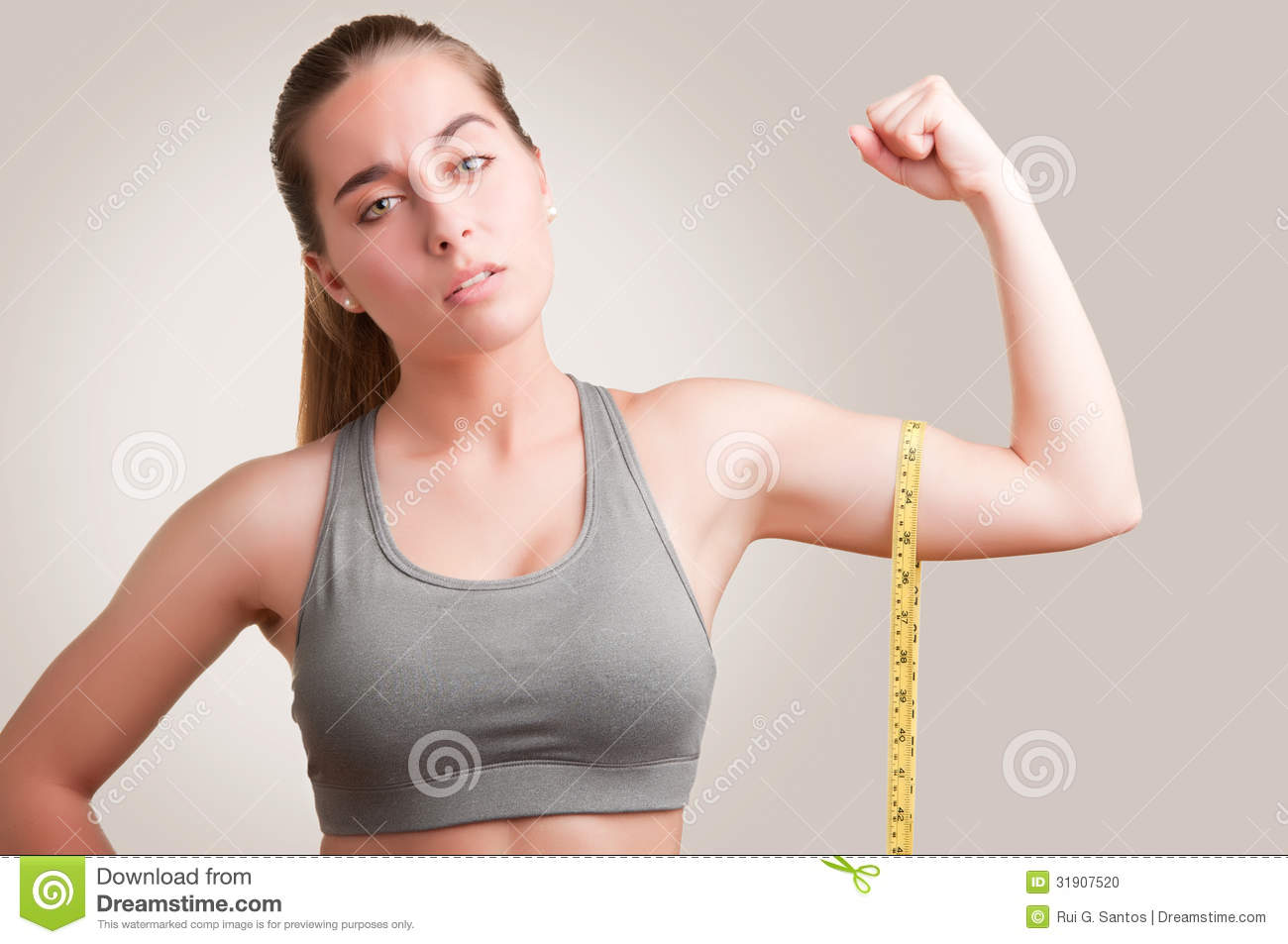 powerful woman stock photo image of measuring muscle 31907520. Black Bedroom Furniture Sets. Home Design Ideas
