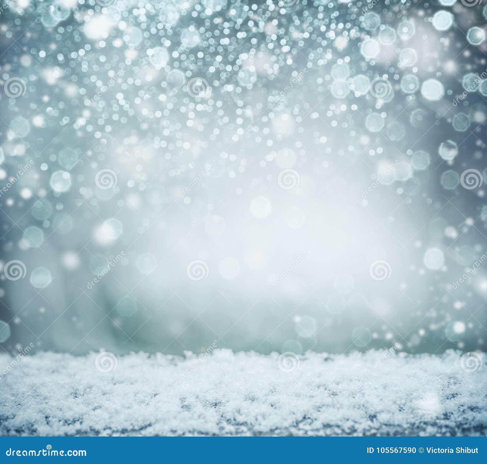 Prachtige de winterachtergrond met sneeuw en bokeh De vakantie van de winter