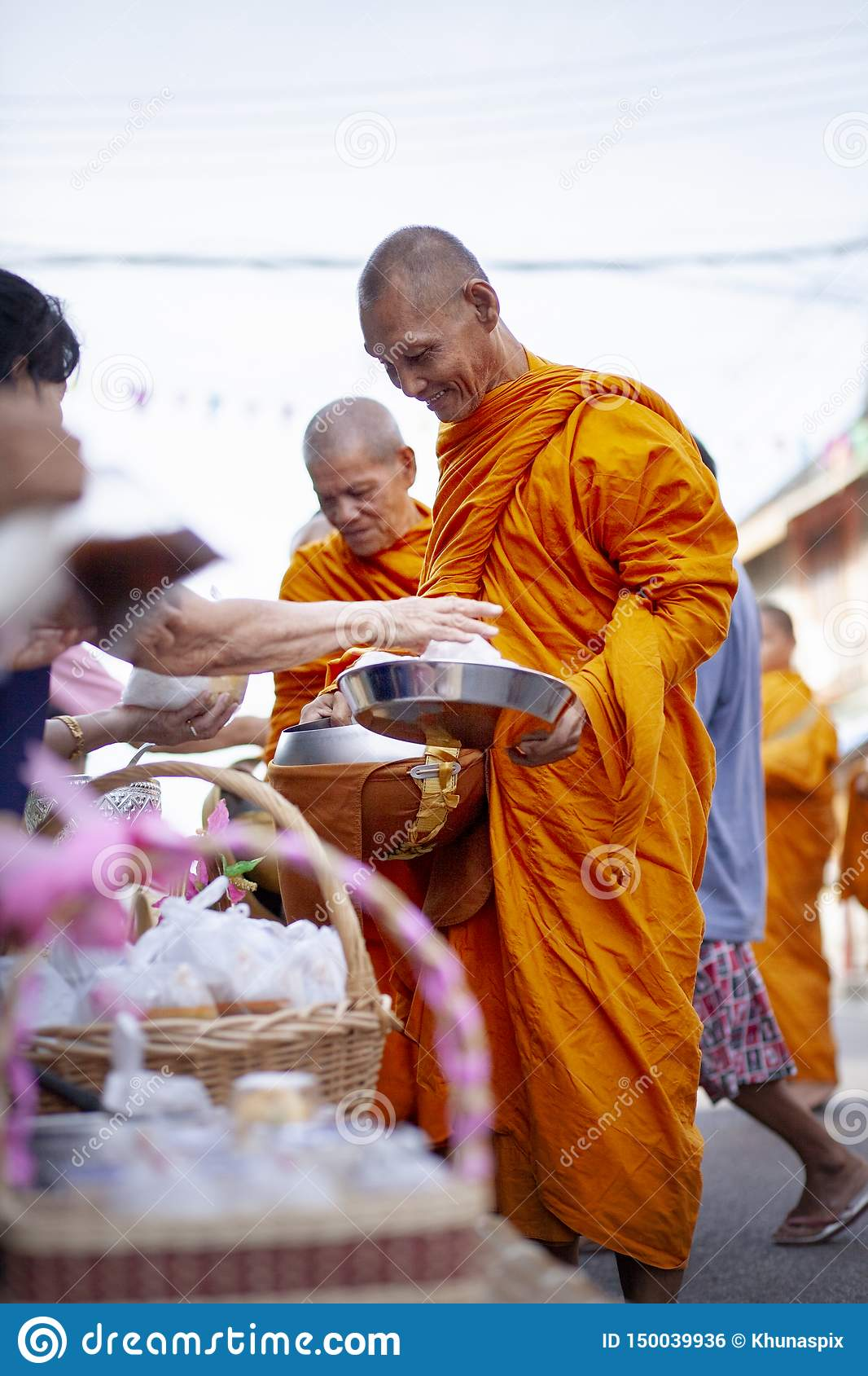 Prachuap khiri khan thailand - june2,2019 : thai woman offering food to thai monk on early morning , buddhism is main religion in