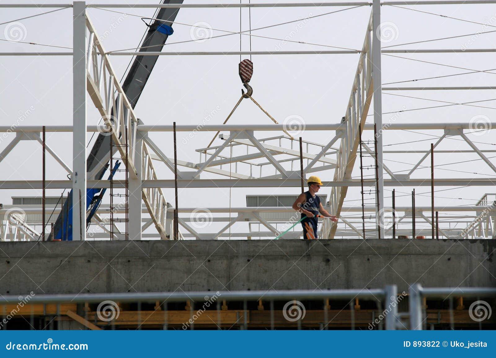 Pracownik firmy budynek budowy