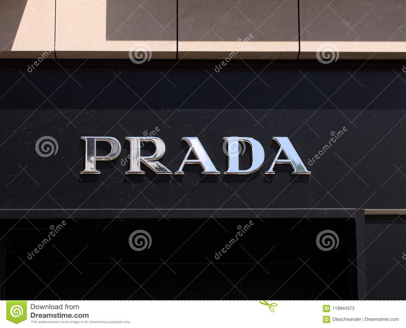 Prada logo on front store in shopping street. Prada is a world famous fashion brand founded in Italy.