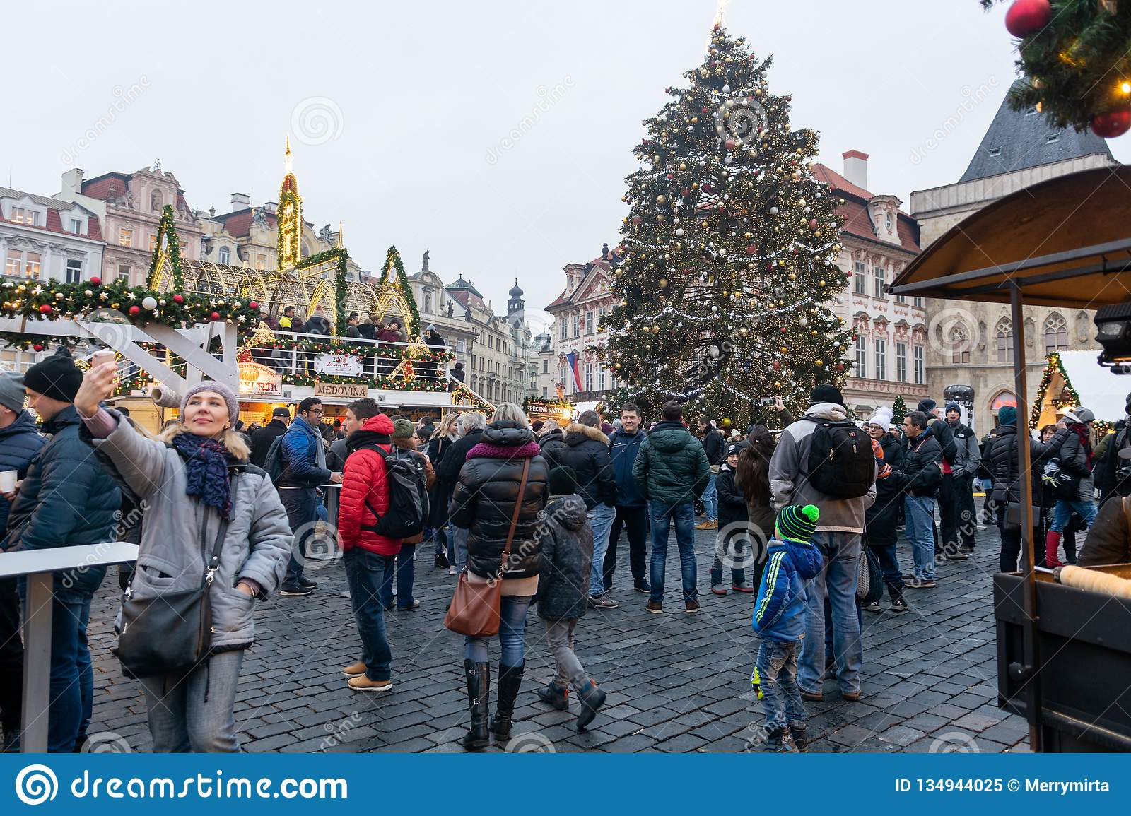 Prague, Czech Republic - December 2018: Christmas market at Old Town Square with gothic Tyne cathedral.