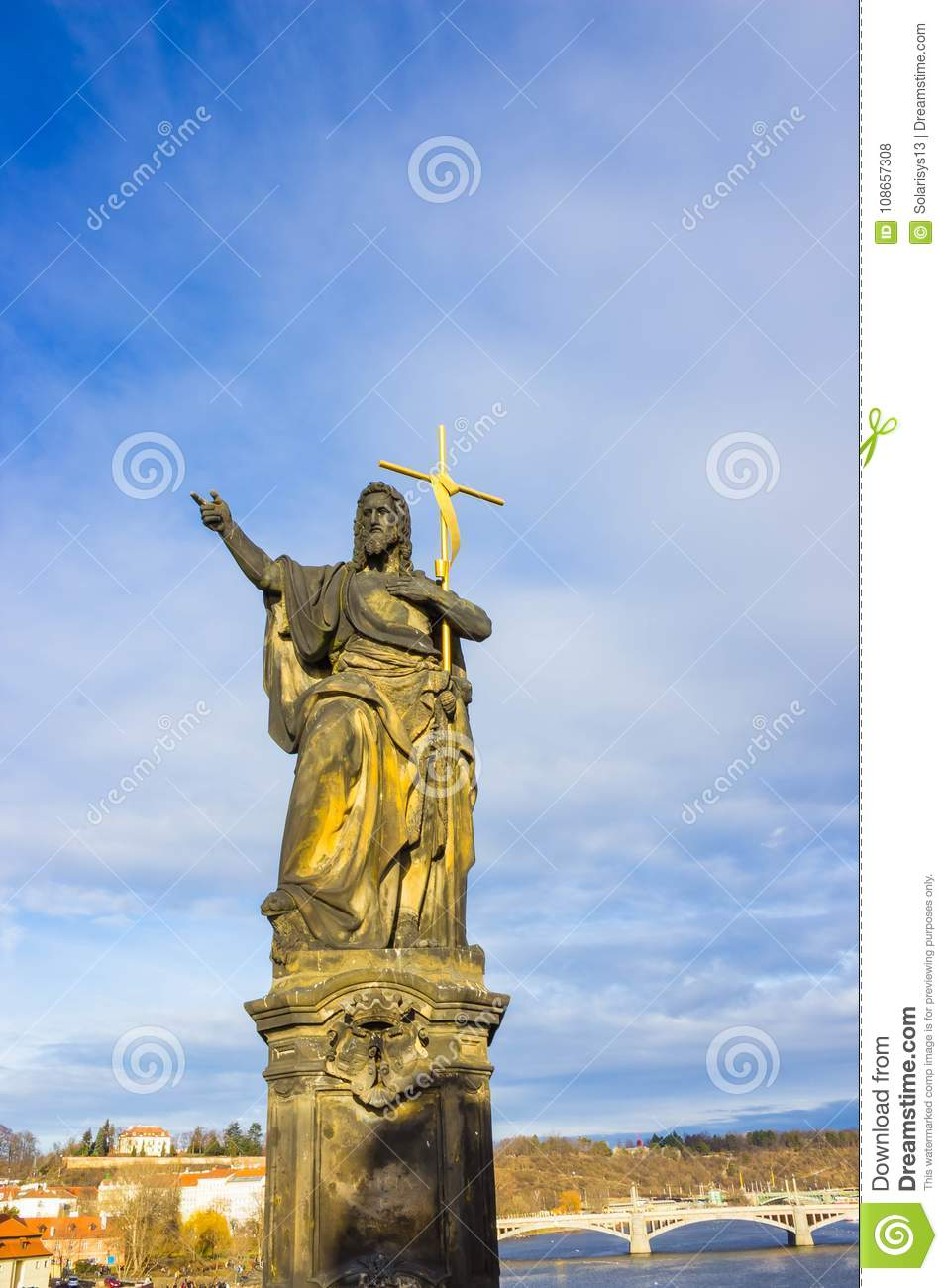 Prague, Czech Republic - December 31, 2017: The gothic sculpture of the John the Baptist on the Charles bridge