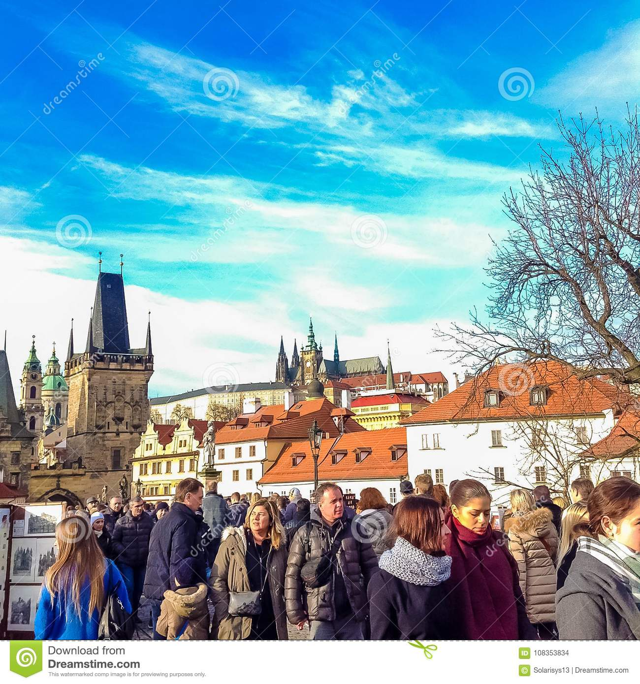 Prague, Czech Republic - December 31, 2017: People walking on the historic Charles Bridge