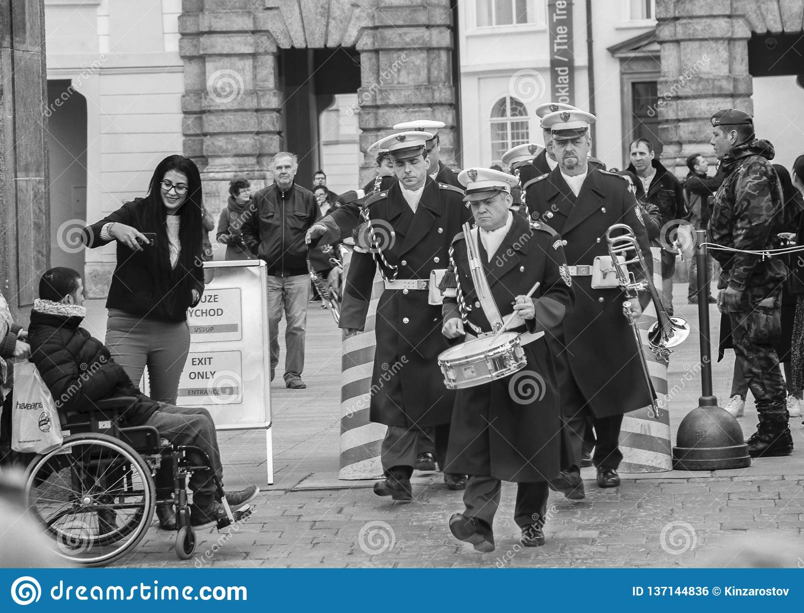 Prague, Czech Republic - March 13, 2017: Military musicians are passing by tourists Black and white image