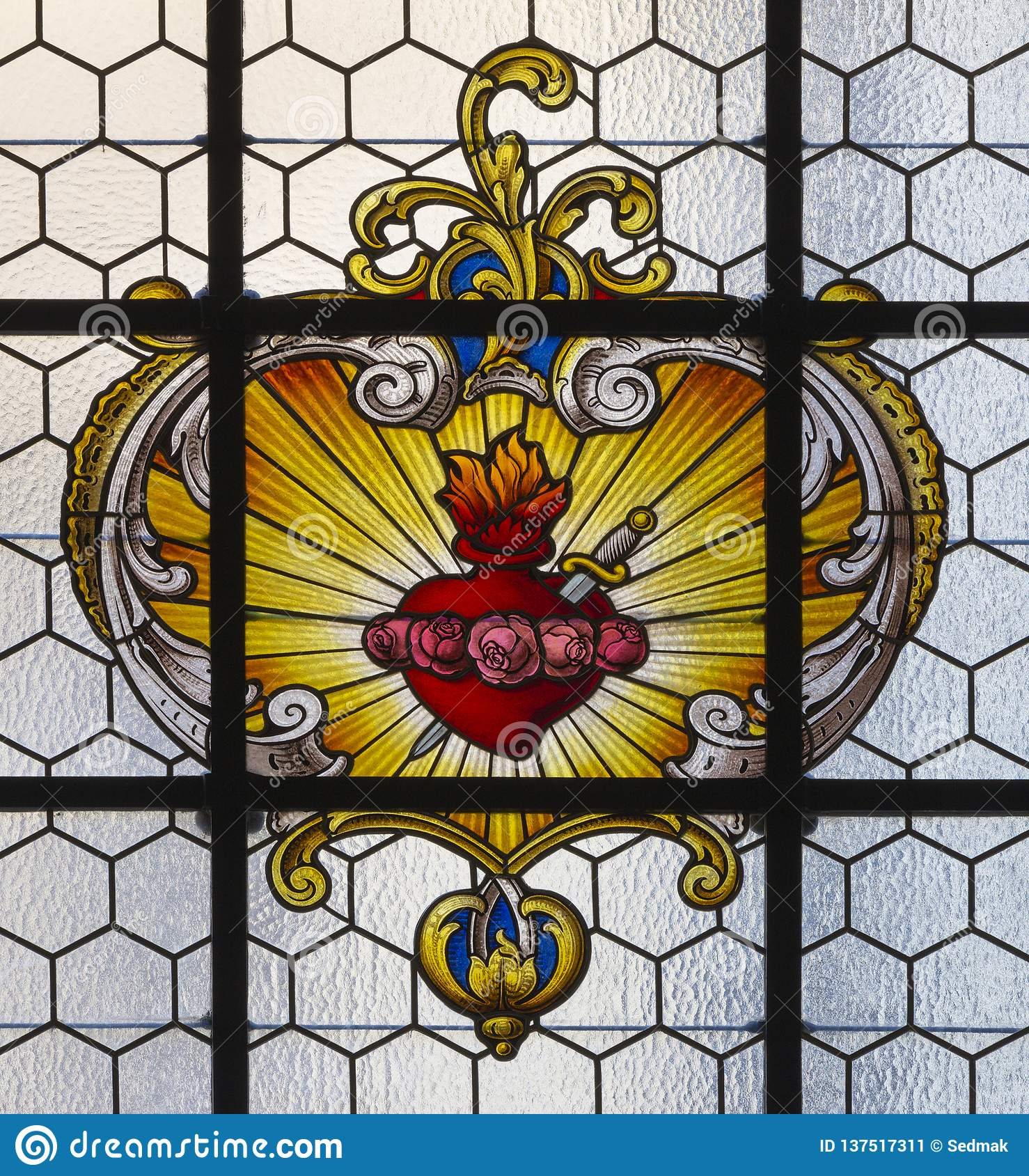 PRAGUE, CZECH REPUBLIC - OCTOBER 16, 2018: The baroque heart of Virgin Mary in the stained glass in church kostel Svatého Havla