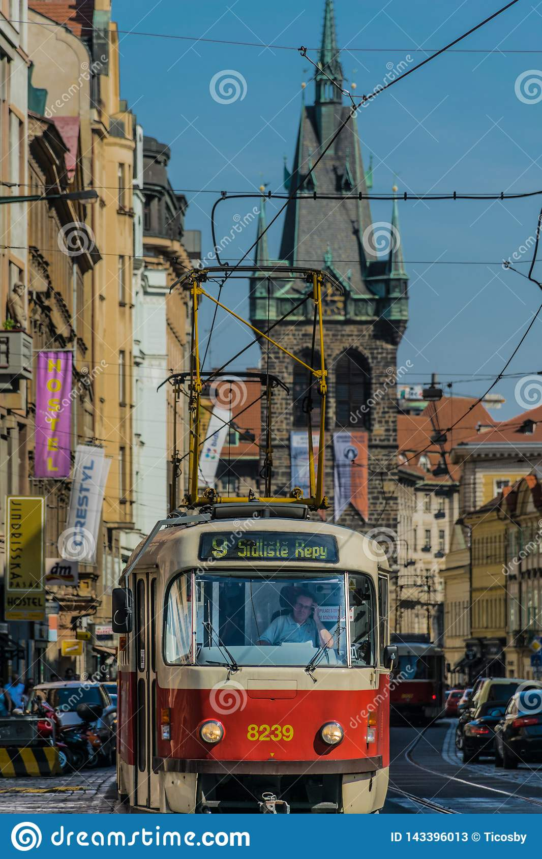 Prague, Czech Republic - September , 17, 2019: Driver of a Retro tram at old town of Prague, with henry`s tower on the