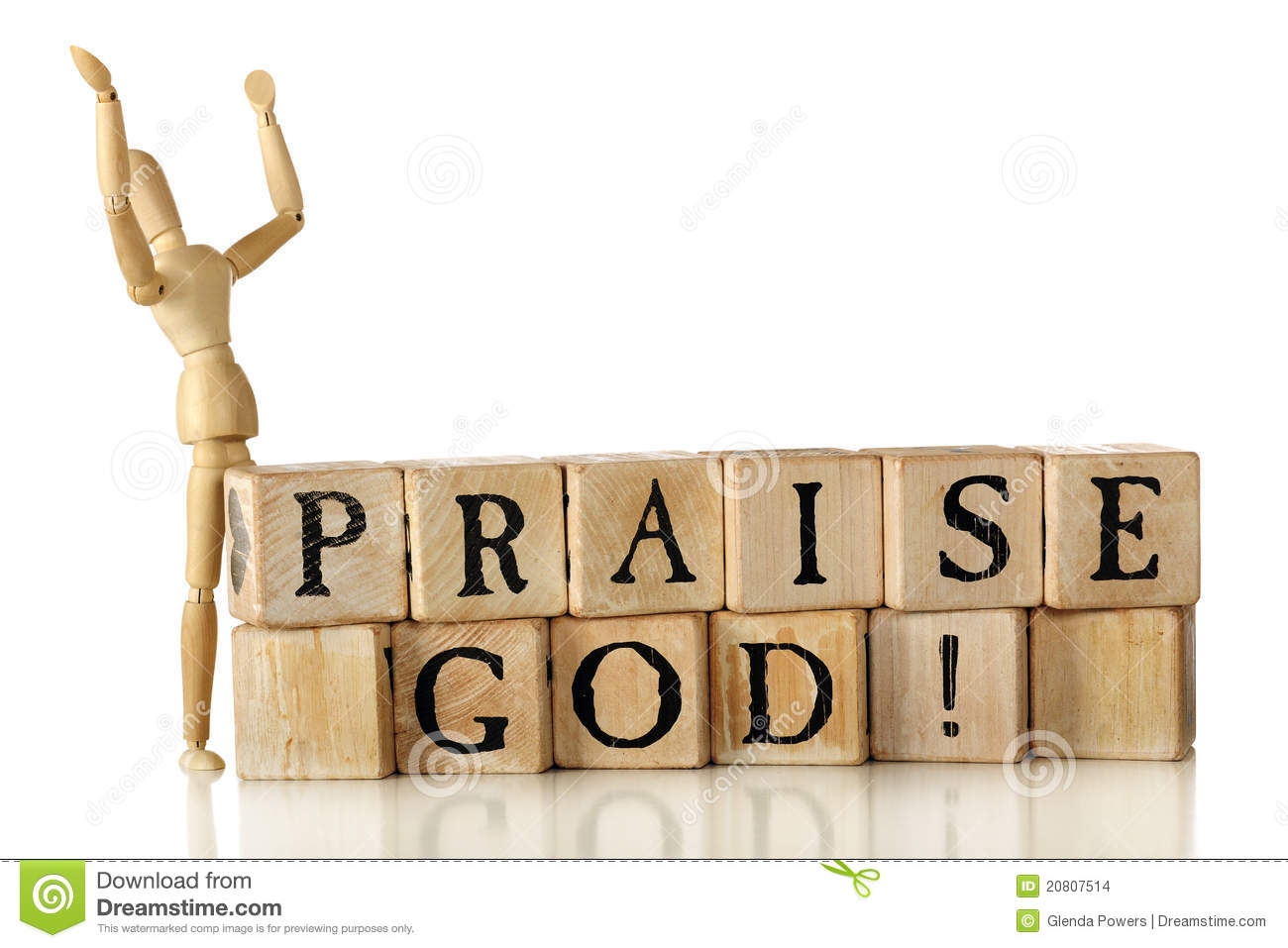 Rustic alphabet blocks arranged to say Praise God! A wooden artist's ...