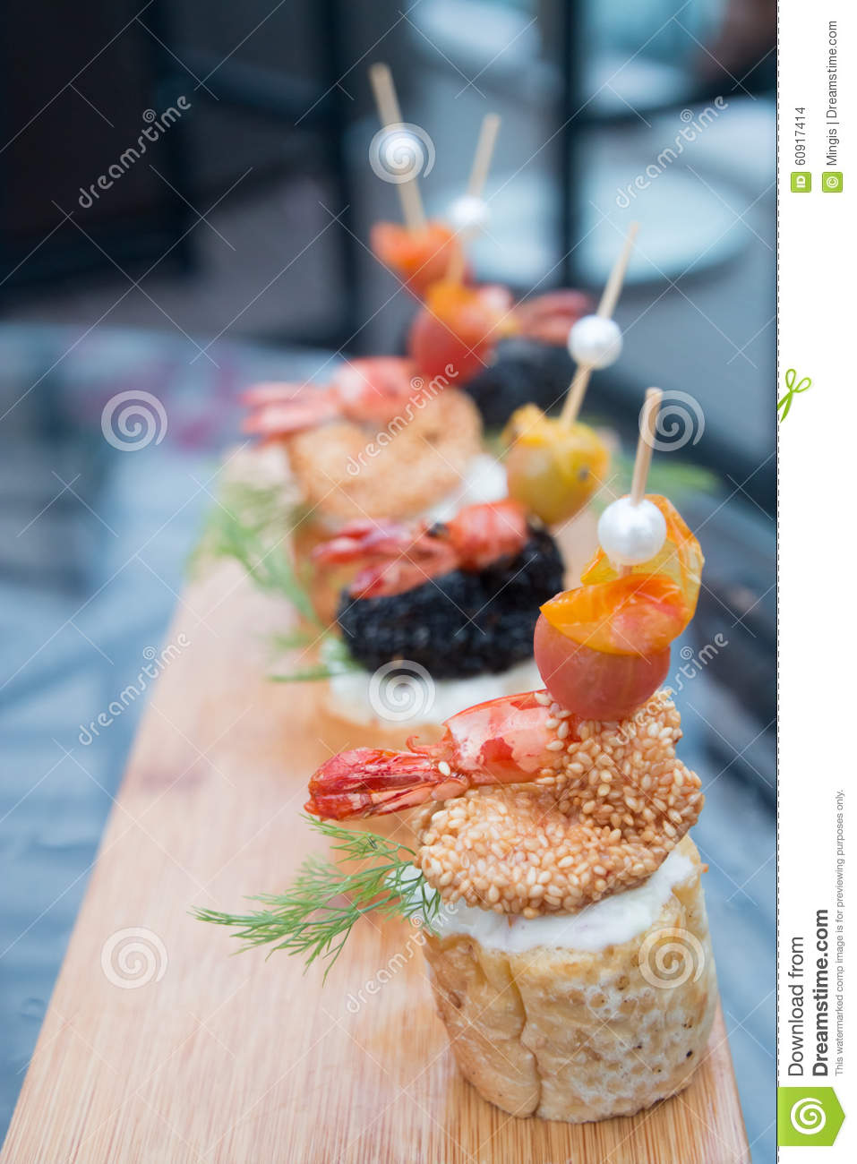 Prawn canapes lined up on a serving platter stock photo for Canape serving platters