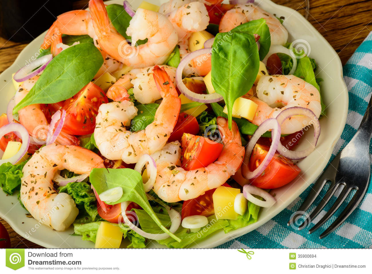Tasty meal with fresh and healthy prawn salad and vegetables.