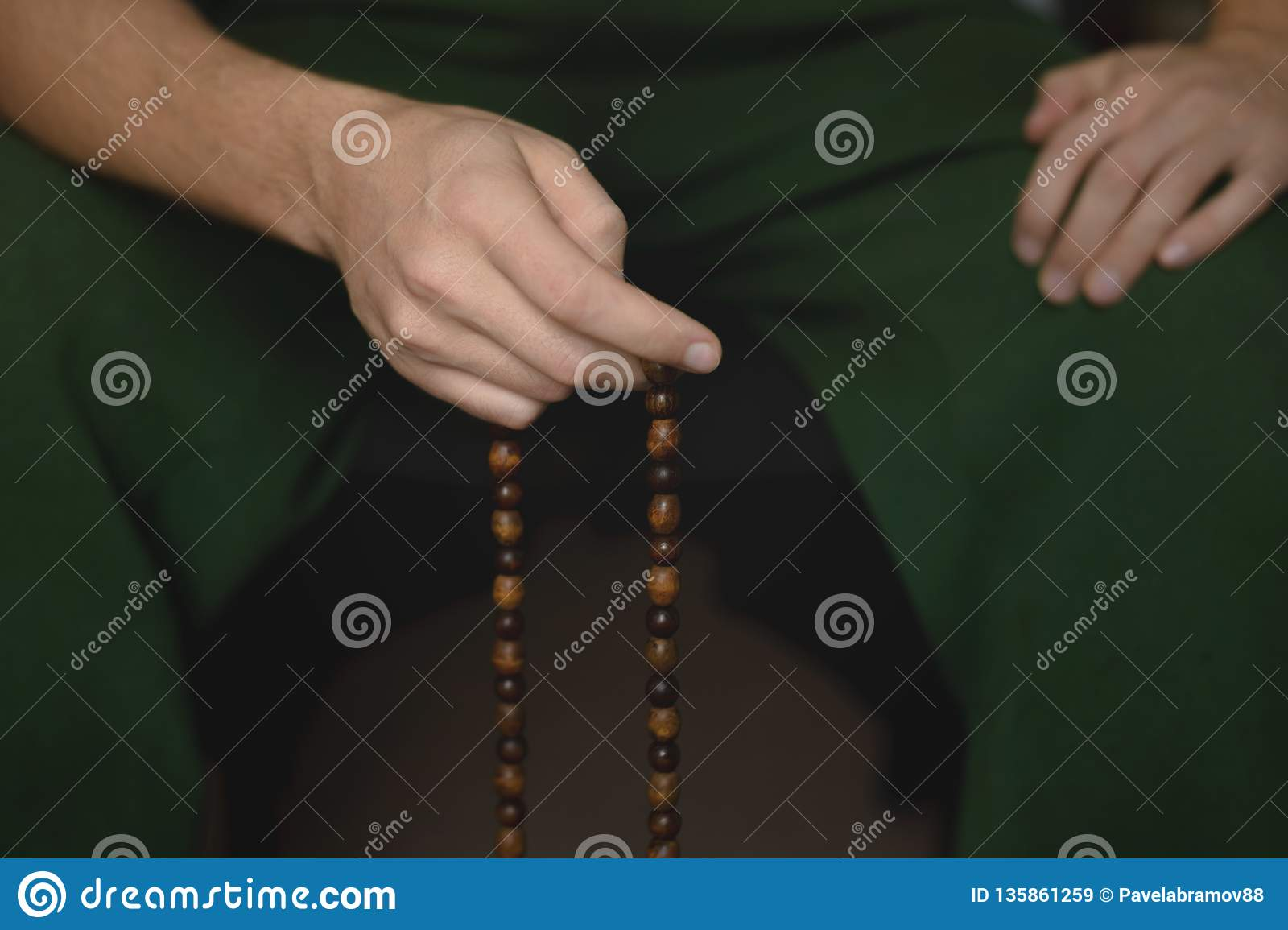 Prayer beads for meditation in men`s hands. Peace, awareness and mindfulness