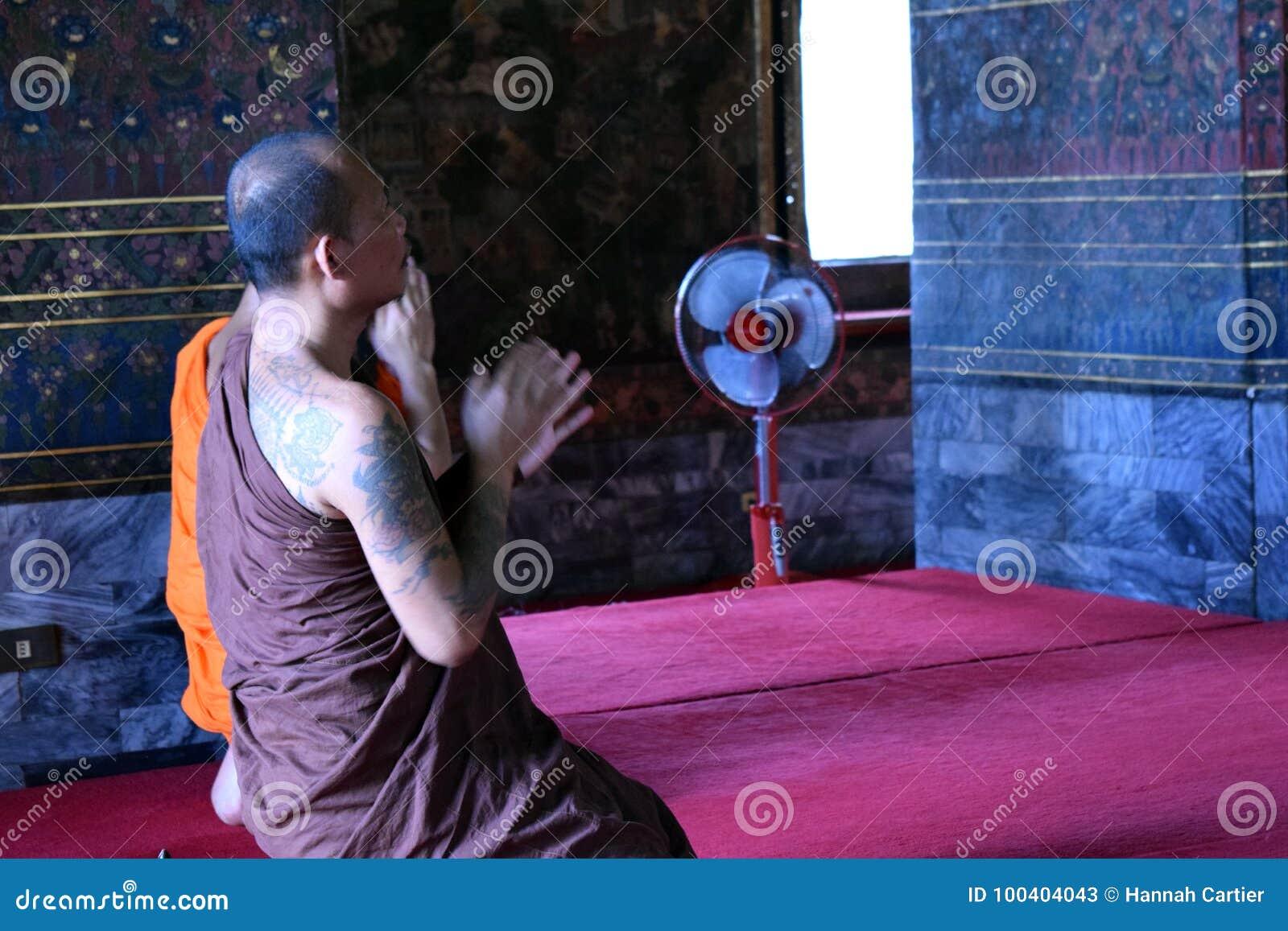 Prayer in Buddhist temple