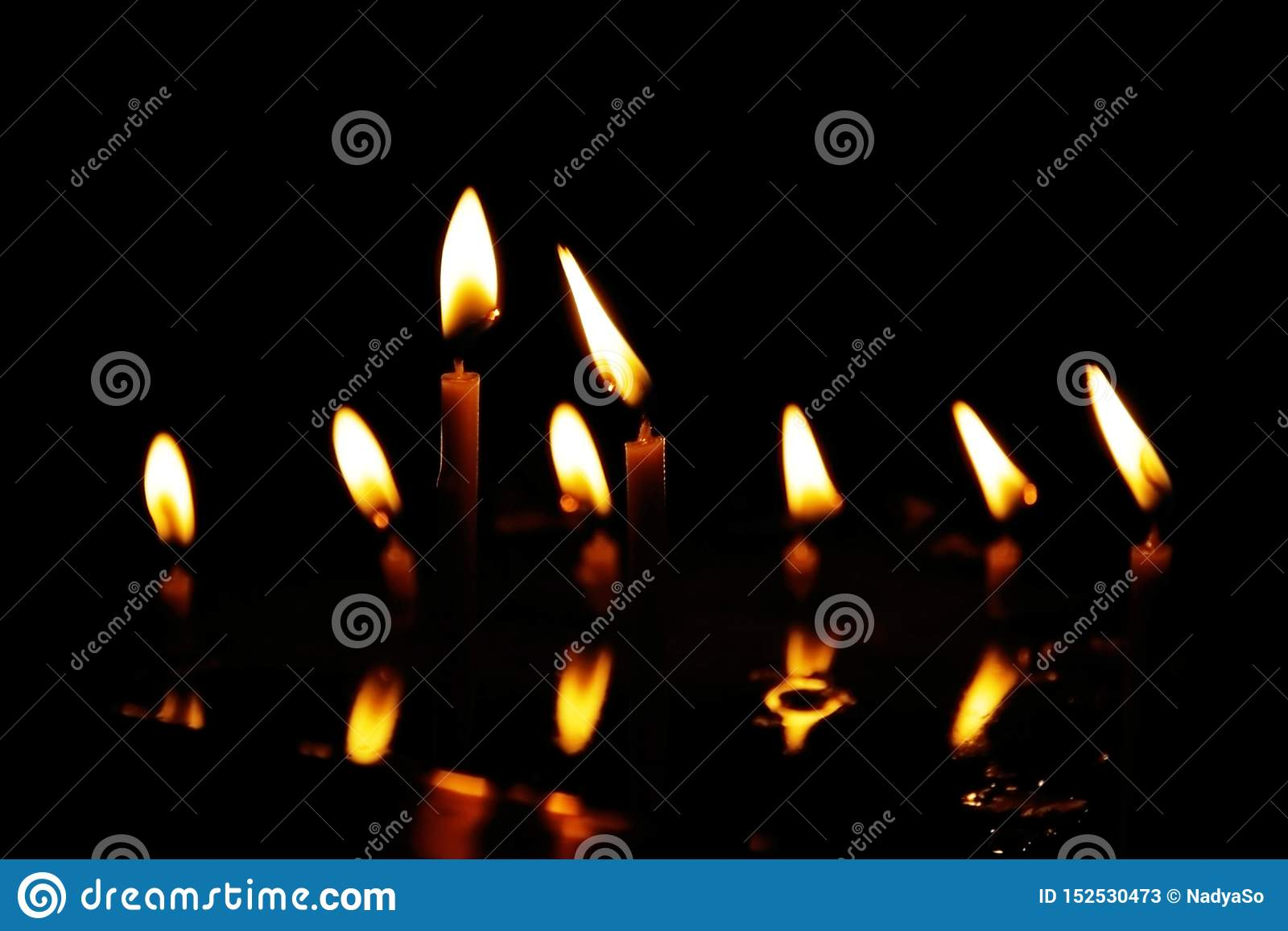 Prayer Candles Burning In Silent Darkness Of Temple