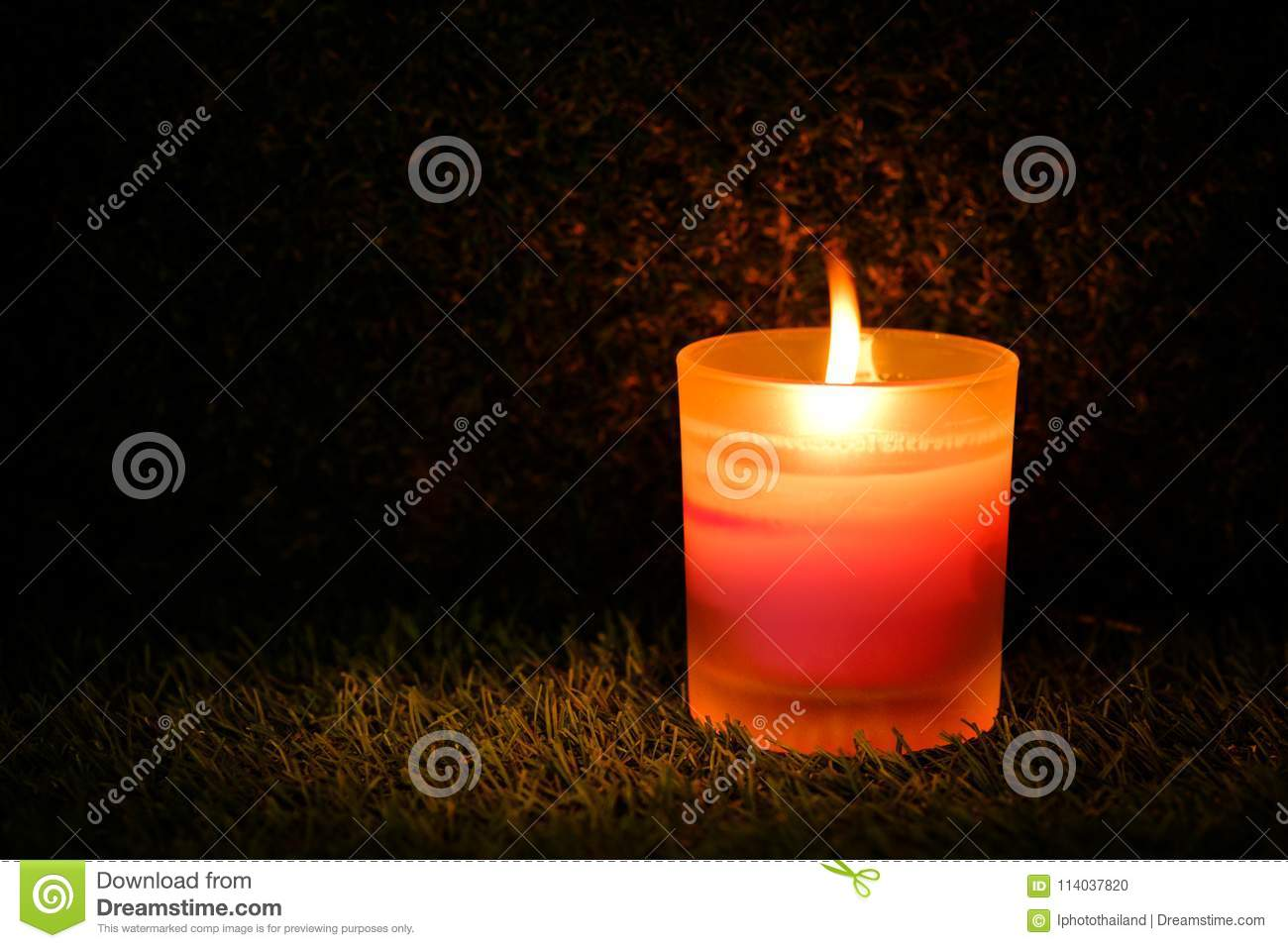 Prayer and hope concept. Retro pink candle light in crystal glass