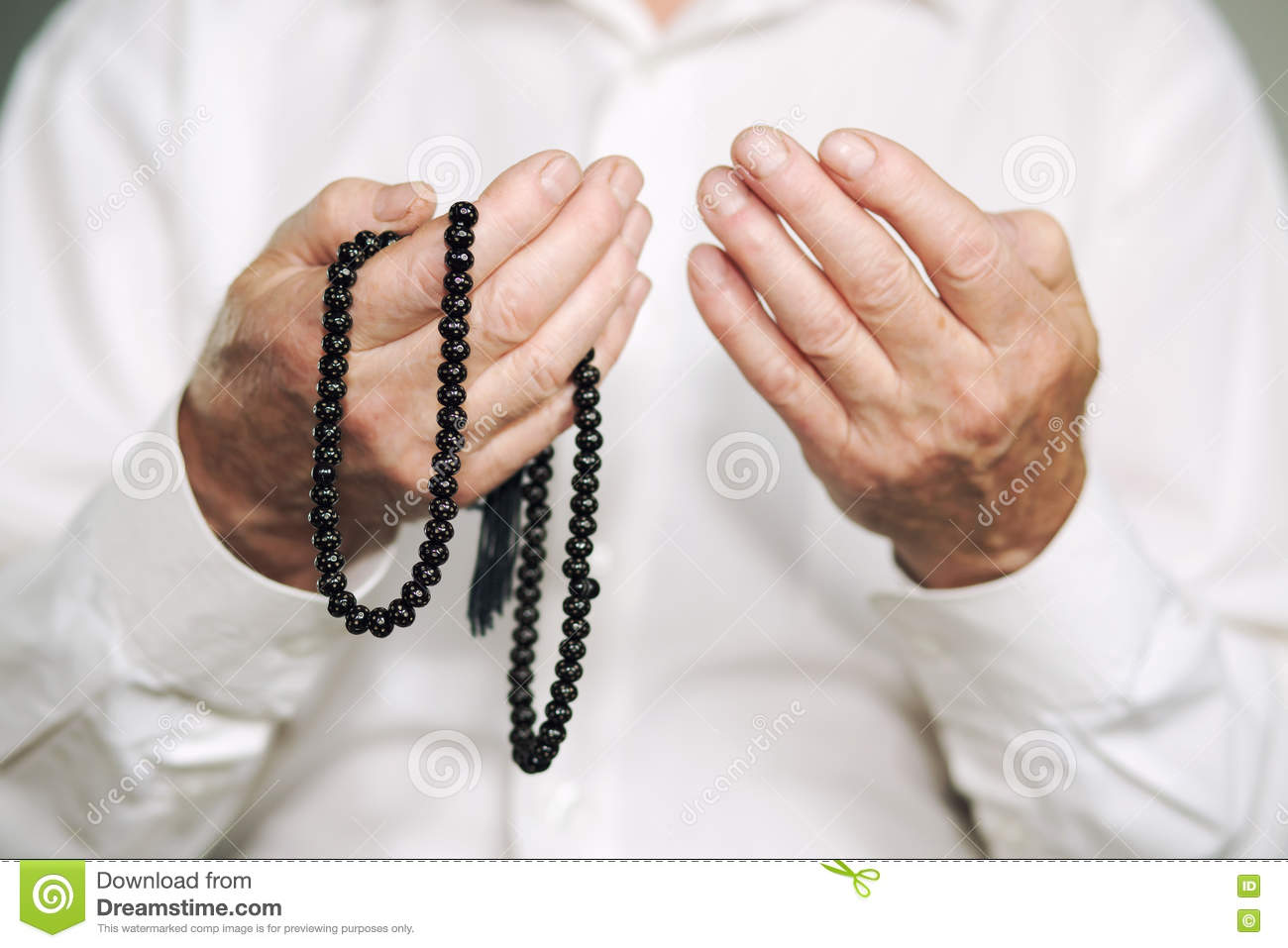 Praying Hands Of An Old Man Holding Rosary Beads Stock Photo Image