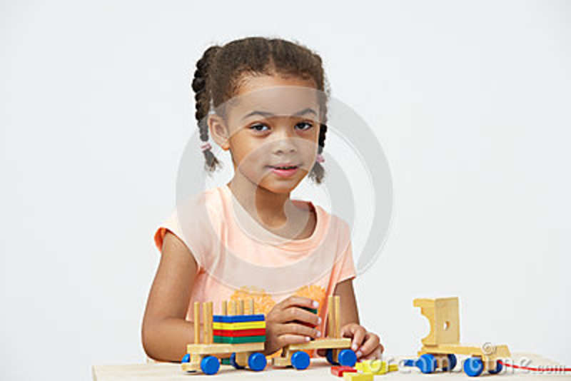 Pre-School Pupil Playing With Wooden Toy Train Royalty Free Stock ...