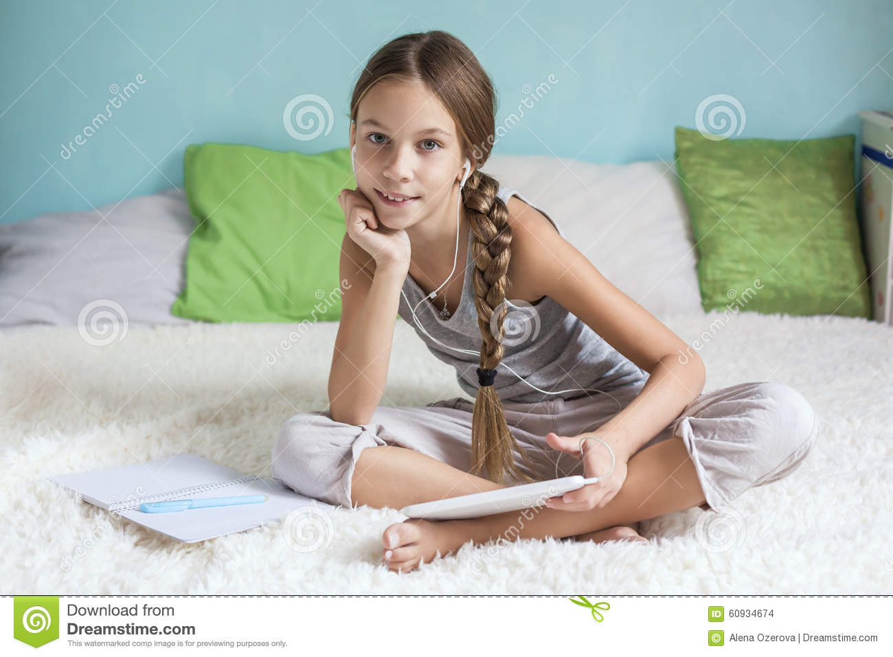 pre teen girl relaxing at home stock photo image of tablet social 60934674. Black Bedroom Furniture Sets. Home Design Ideas