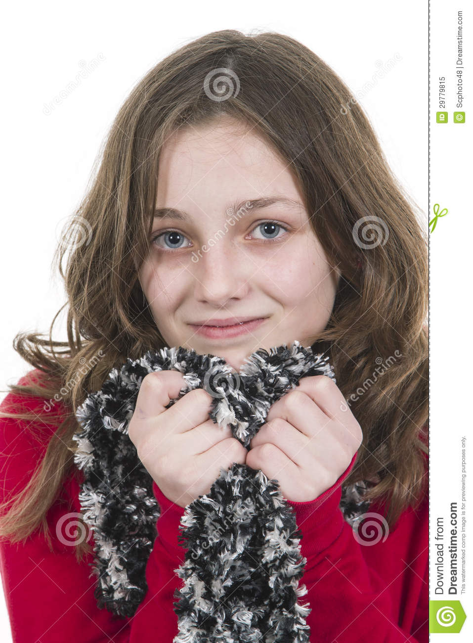 Pre teen young girl posing with scarf held to chin.