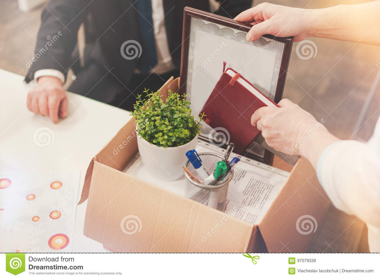 precise neat man packing all his documents in a box stock image