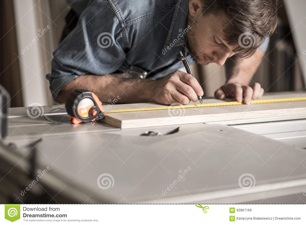 Precise young carpenter during work