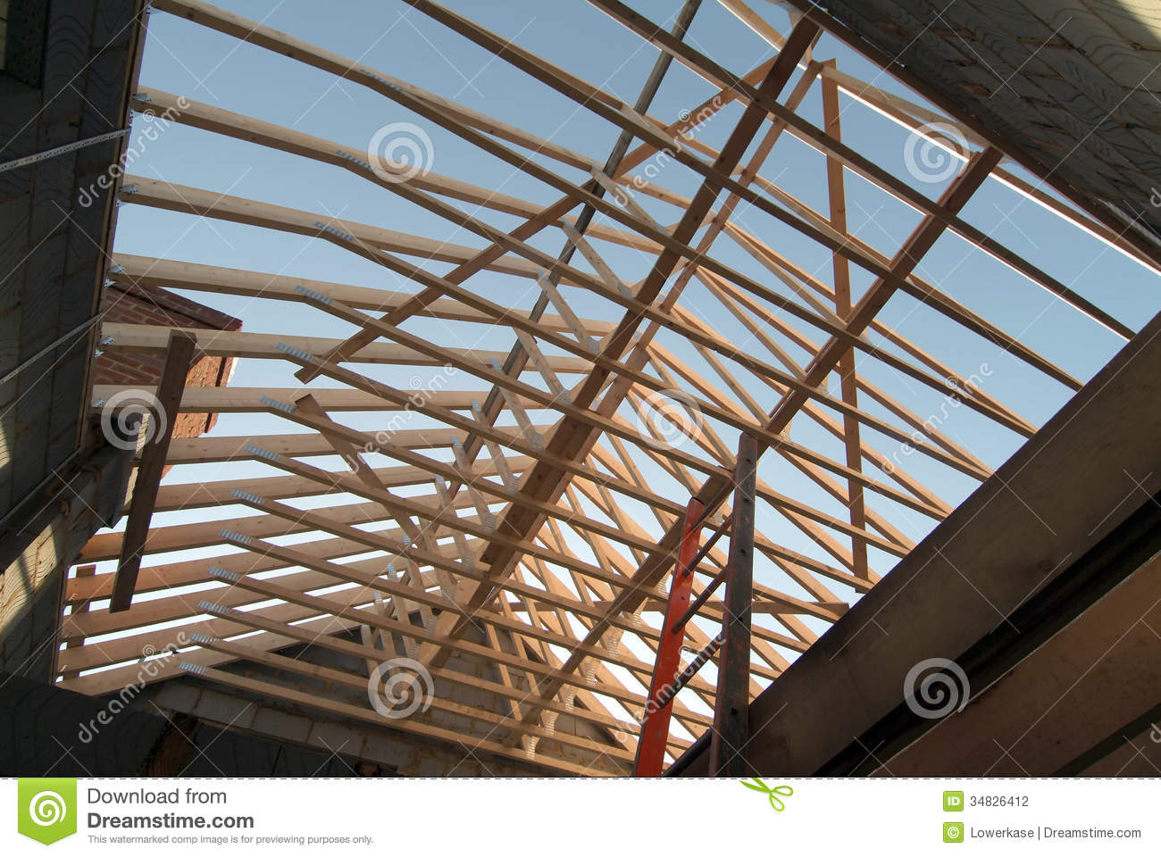 Prefabricated roof trusses on new detached house stock for Manufactured roof trusses