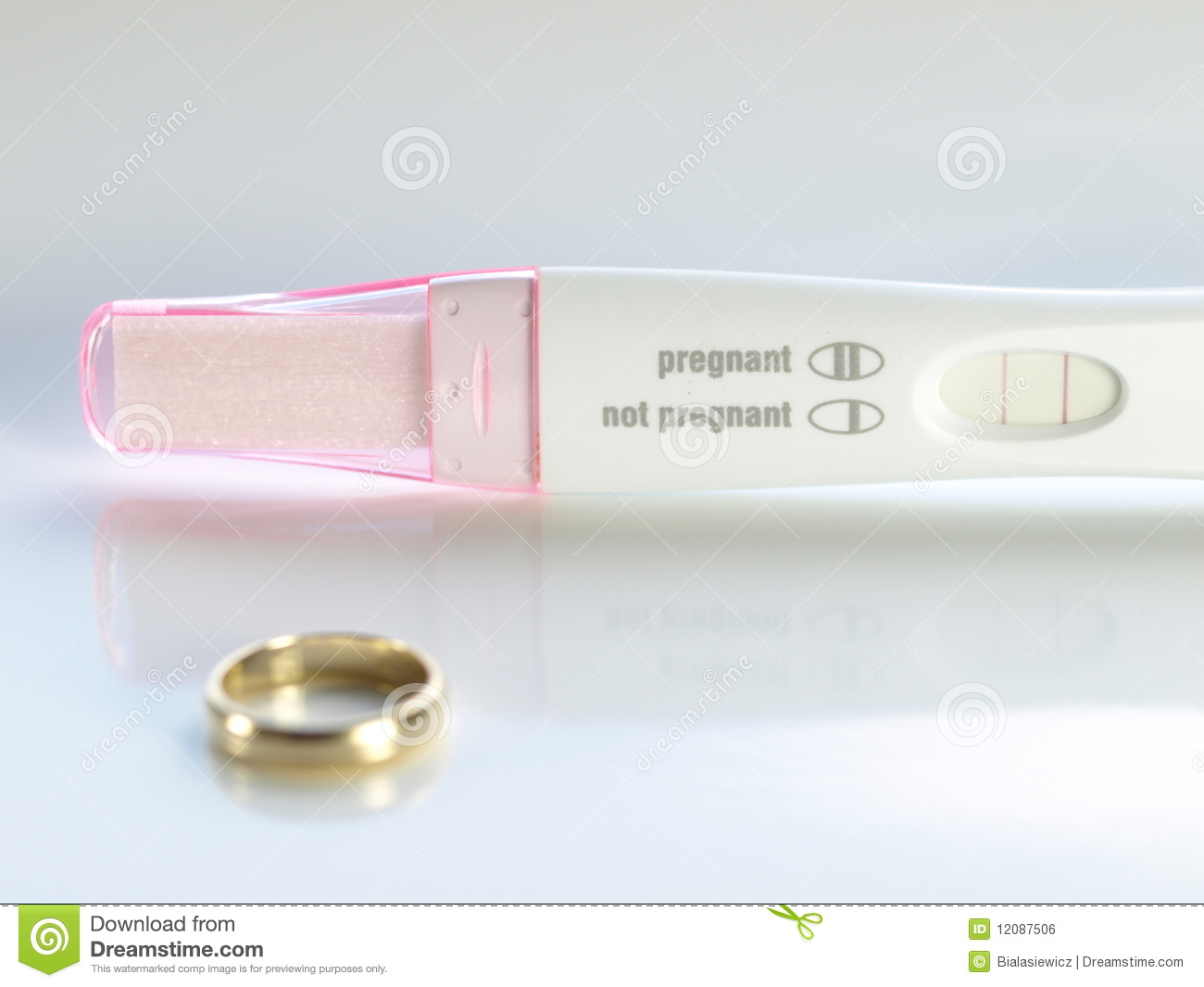 photo on plastic test and the table wedding pregnancy rings stock two
