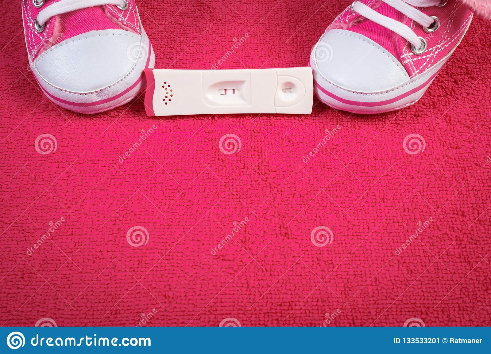 Pregnancy Test With Positive Result And Baby Shoes ...