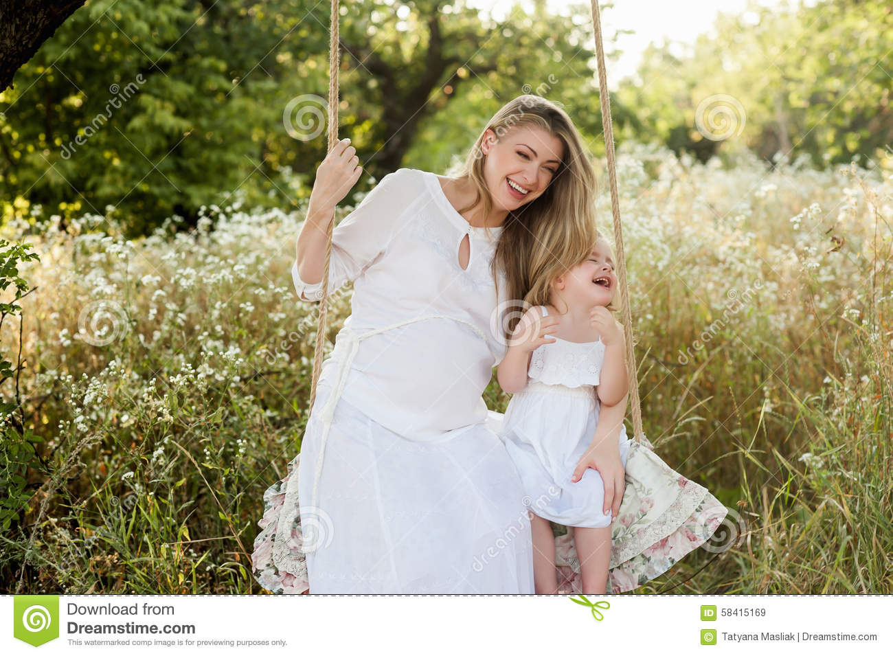 Pregnant Beautiful Mother With Little Blonde Girl In A