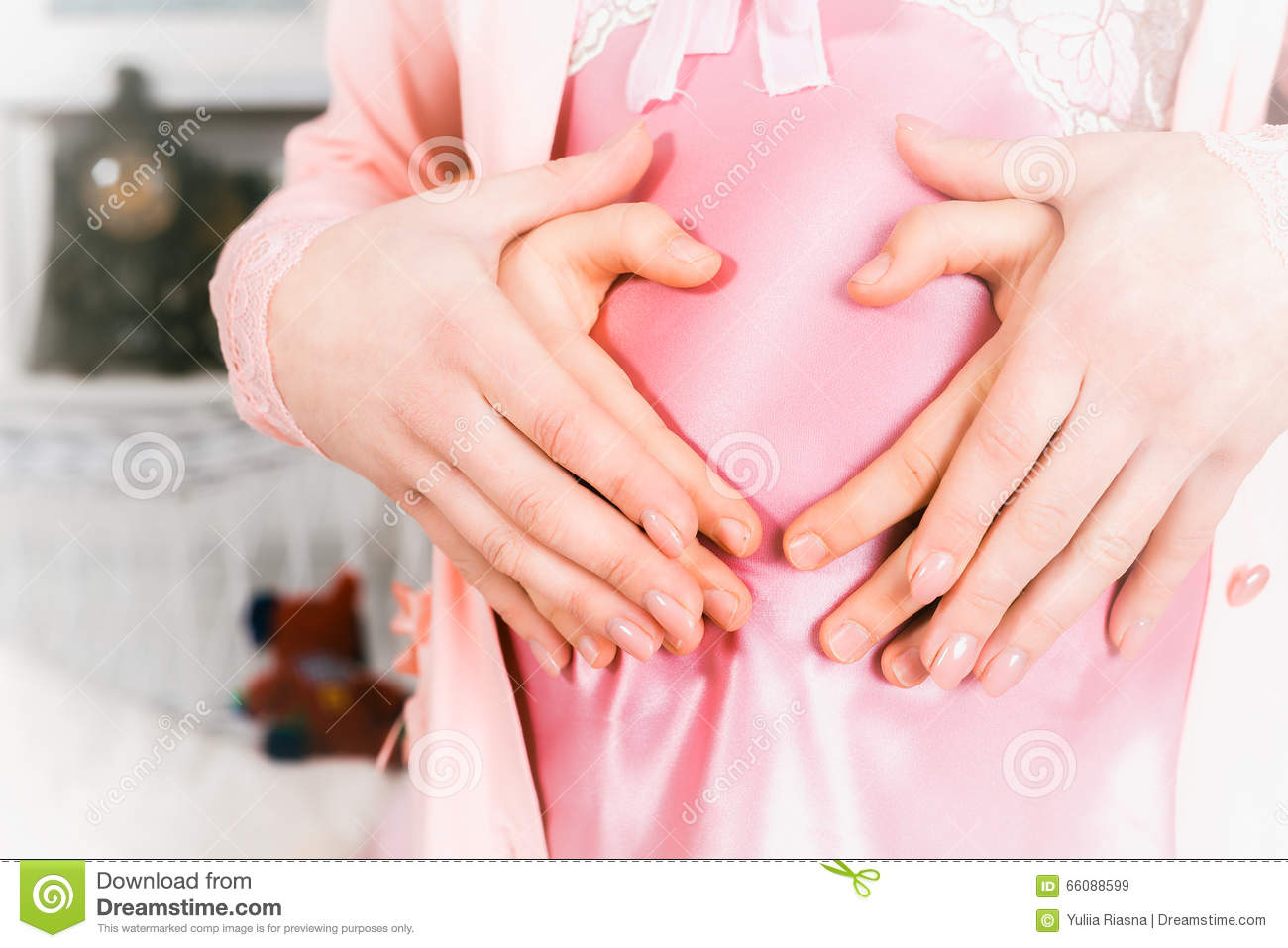 Pregnant Belly With Fingers Heart Symbol. Pregnant Woman And Her ...