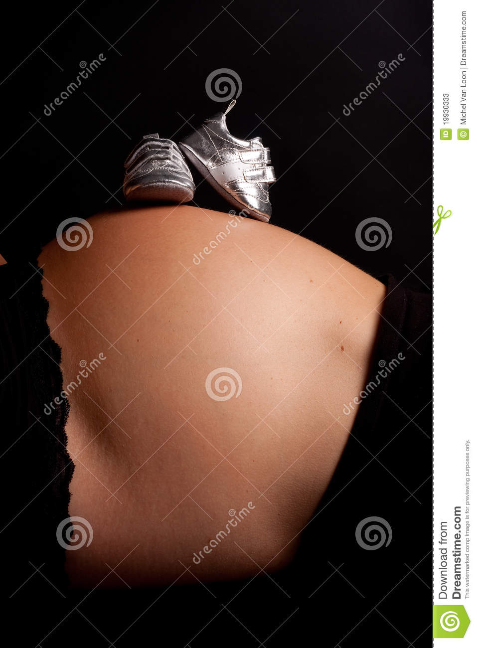 Stock Photos: Pregnant belly with silver shoes