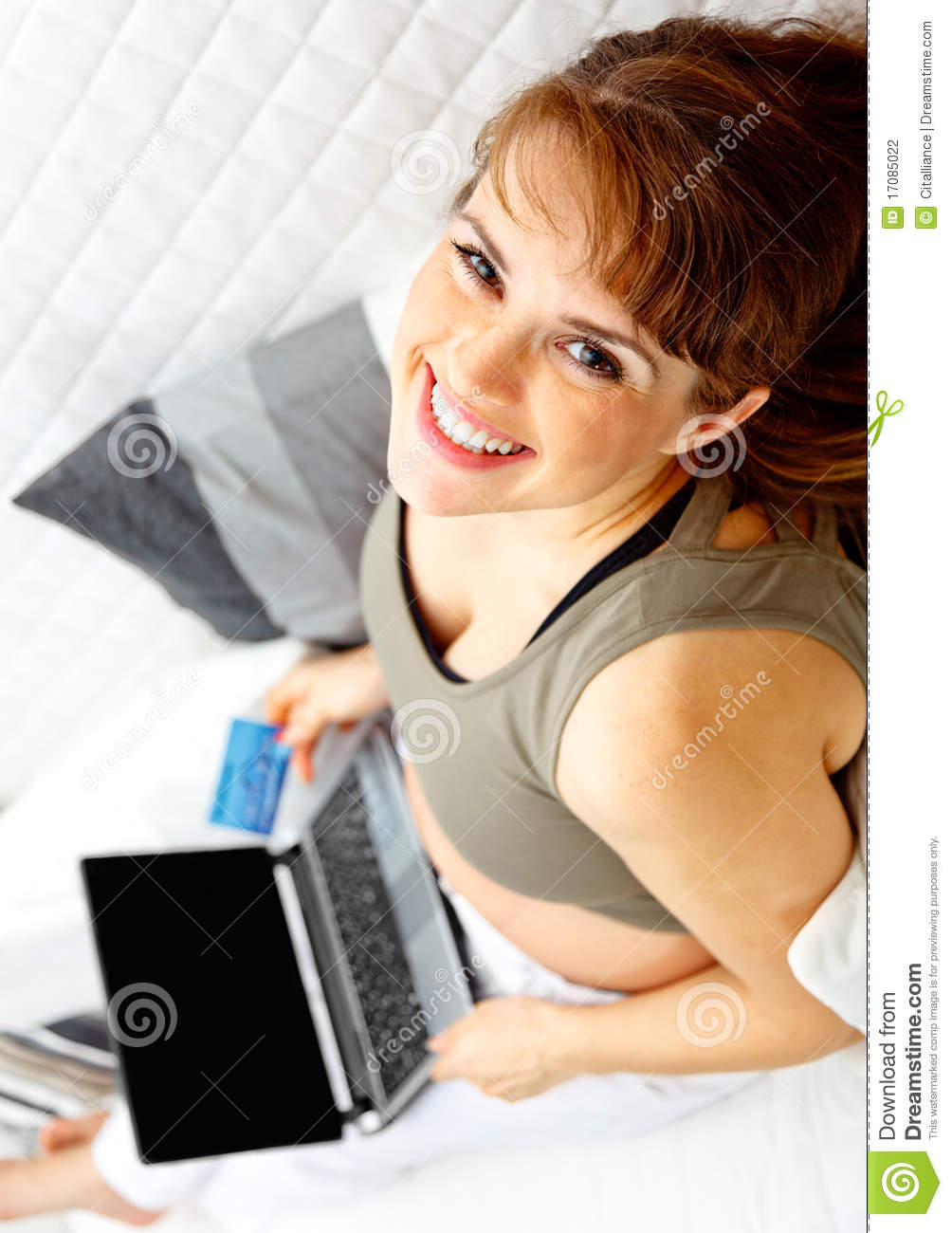 Pregnant female with the laptop and credit card