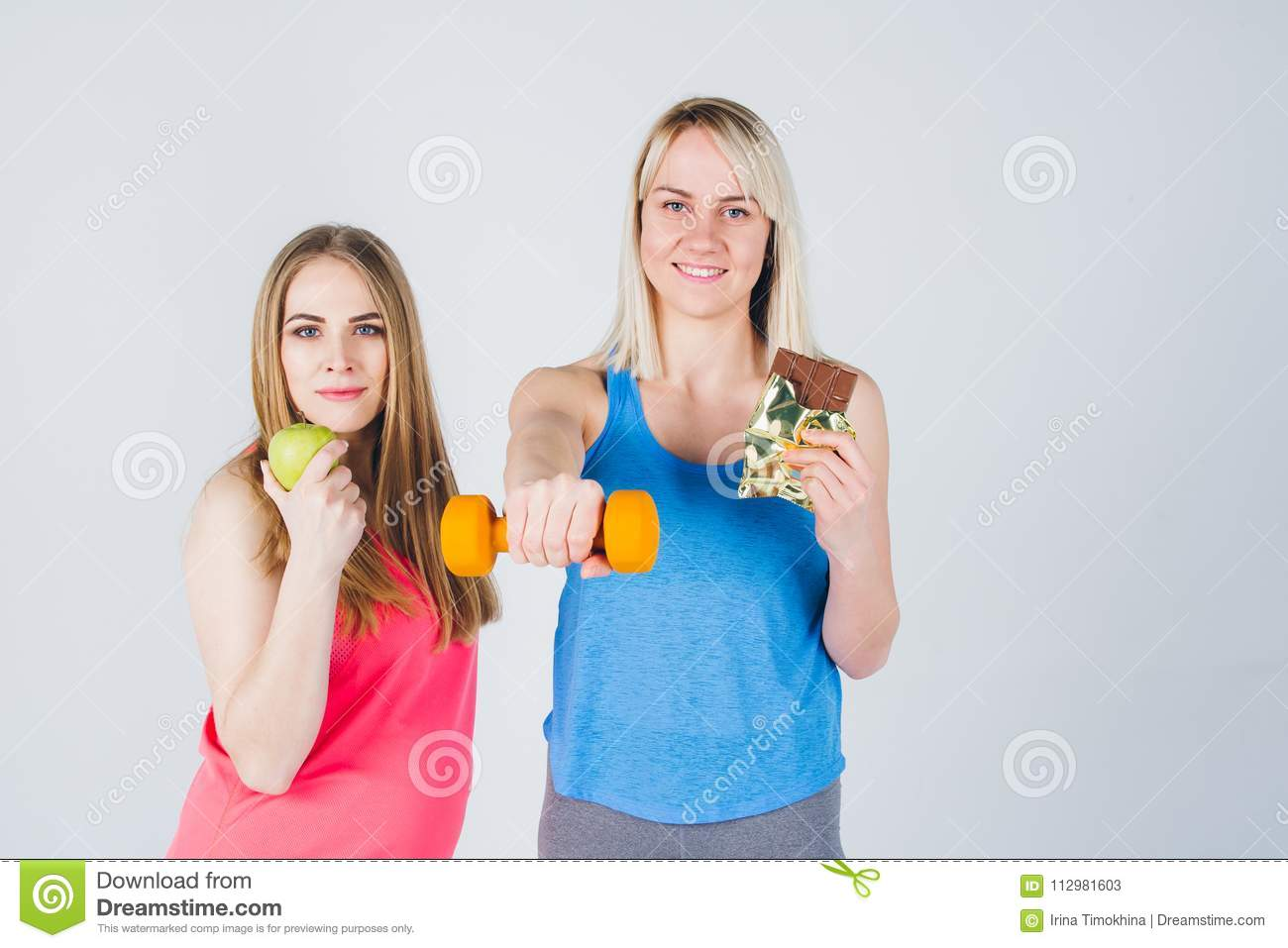 Pregnant girl and her friend eat an Apple and chocolate
