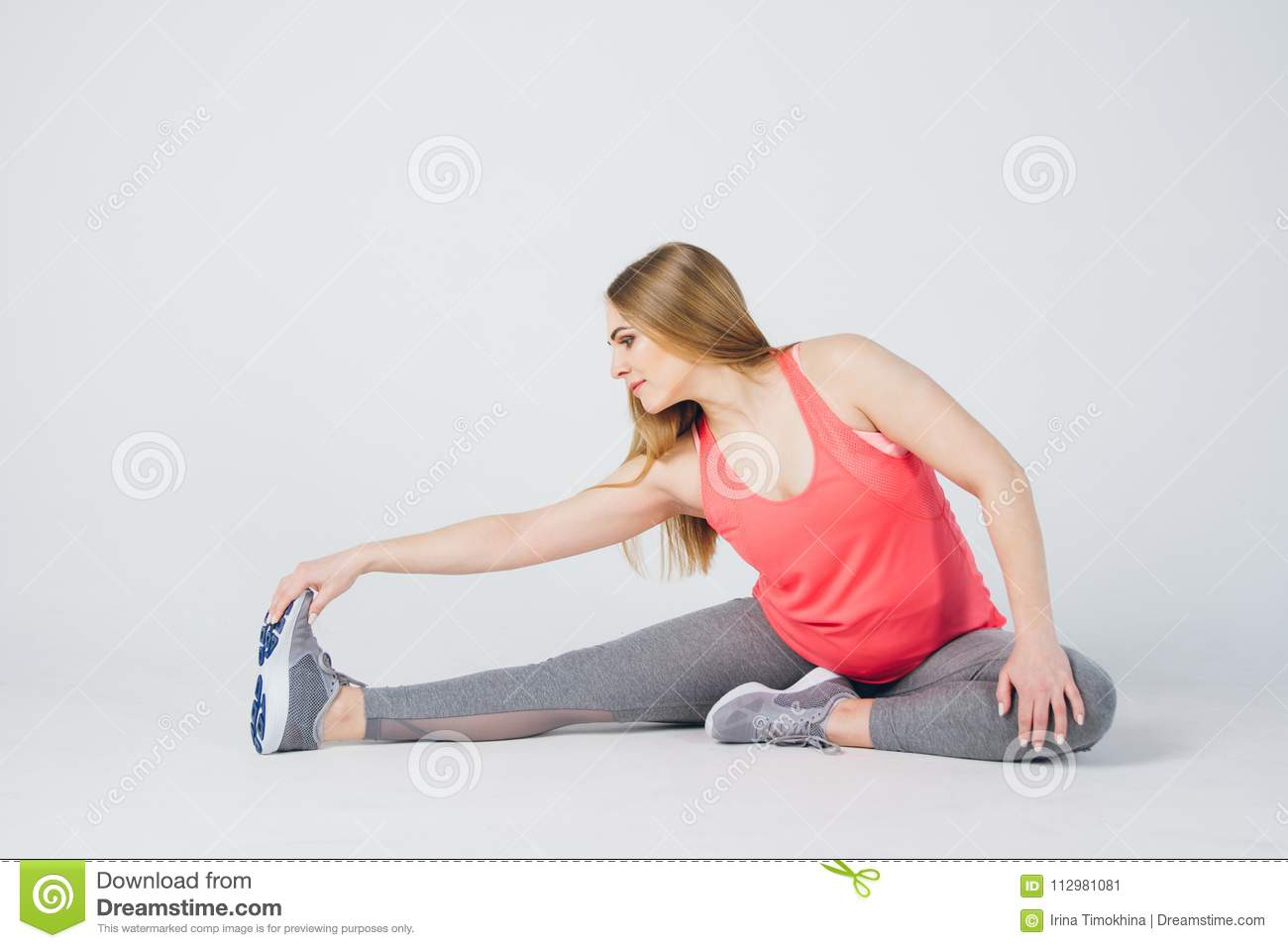 Pregnant girl in sportswear is engaged in fitness