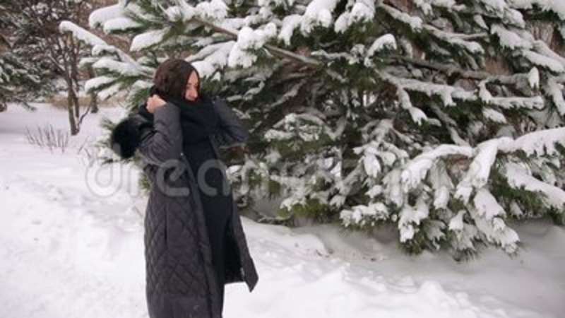 539637af7c Pregnant Girl Wears A Scarf In The Winter Outdoors Stock Video ...