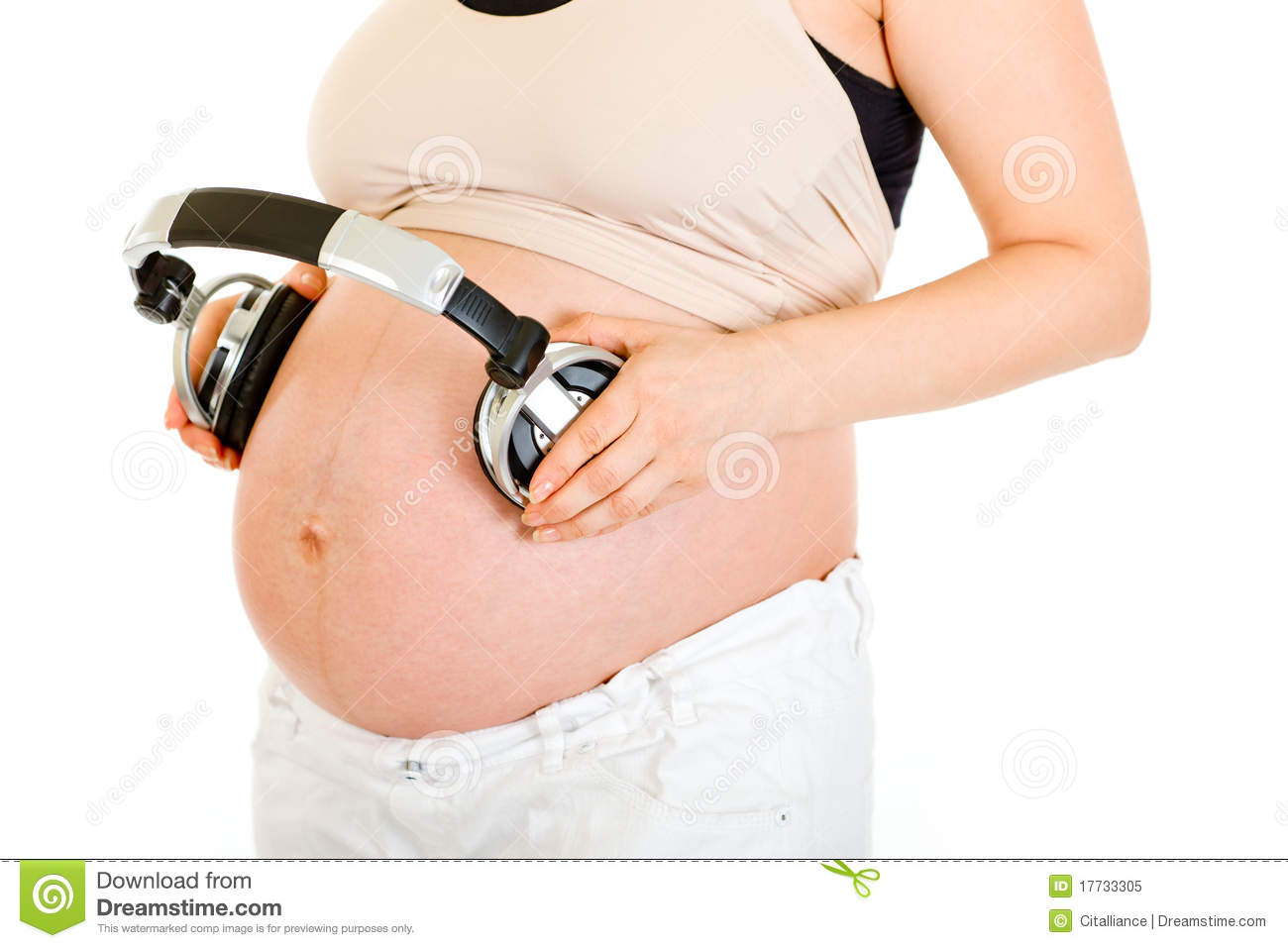 pregnant-headphones-belly-close-up-17733305.jpg