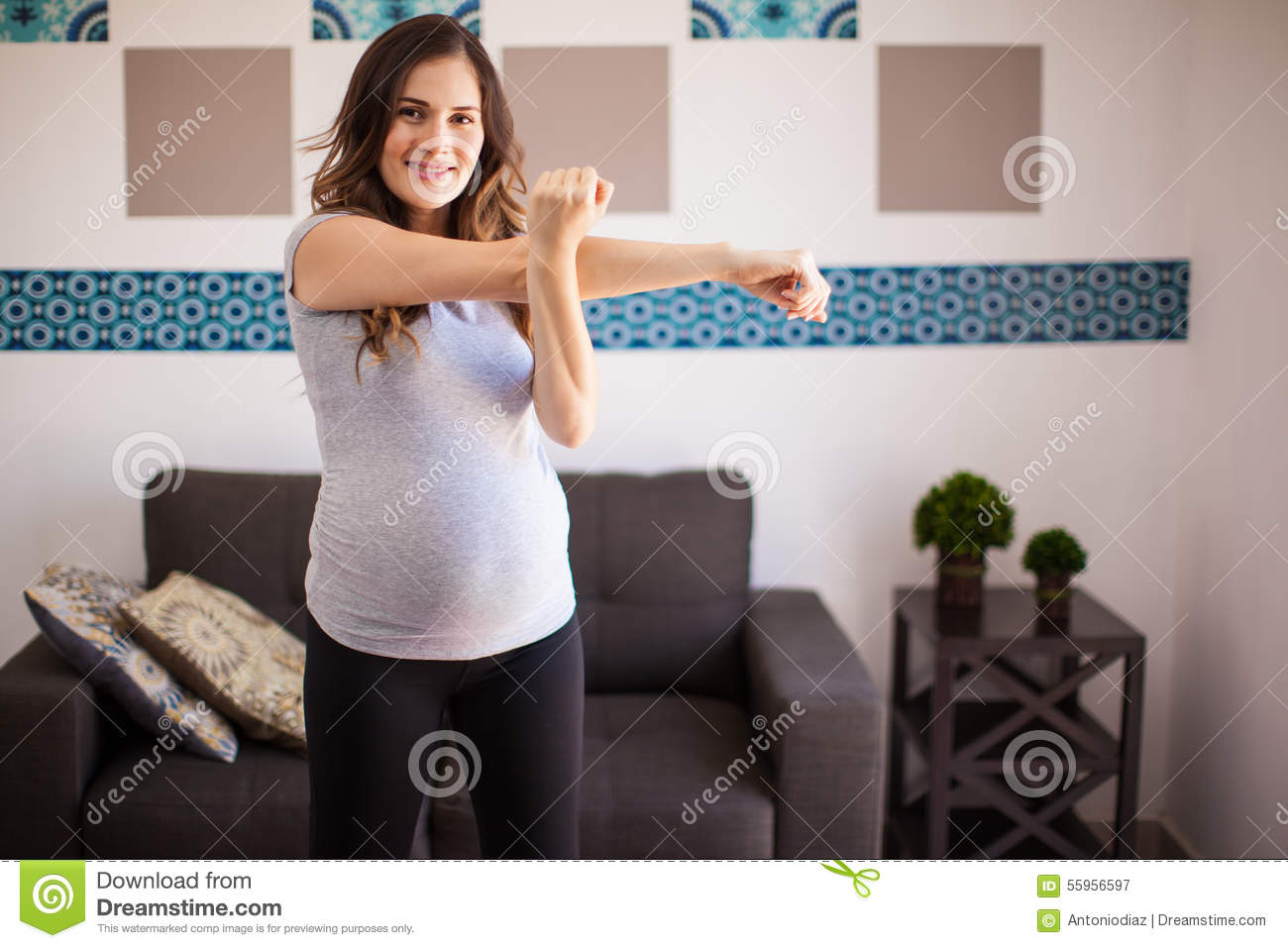 Pregnant Mom Ready For Exercise Stock Photo